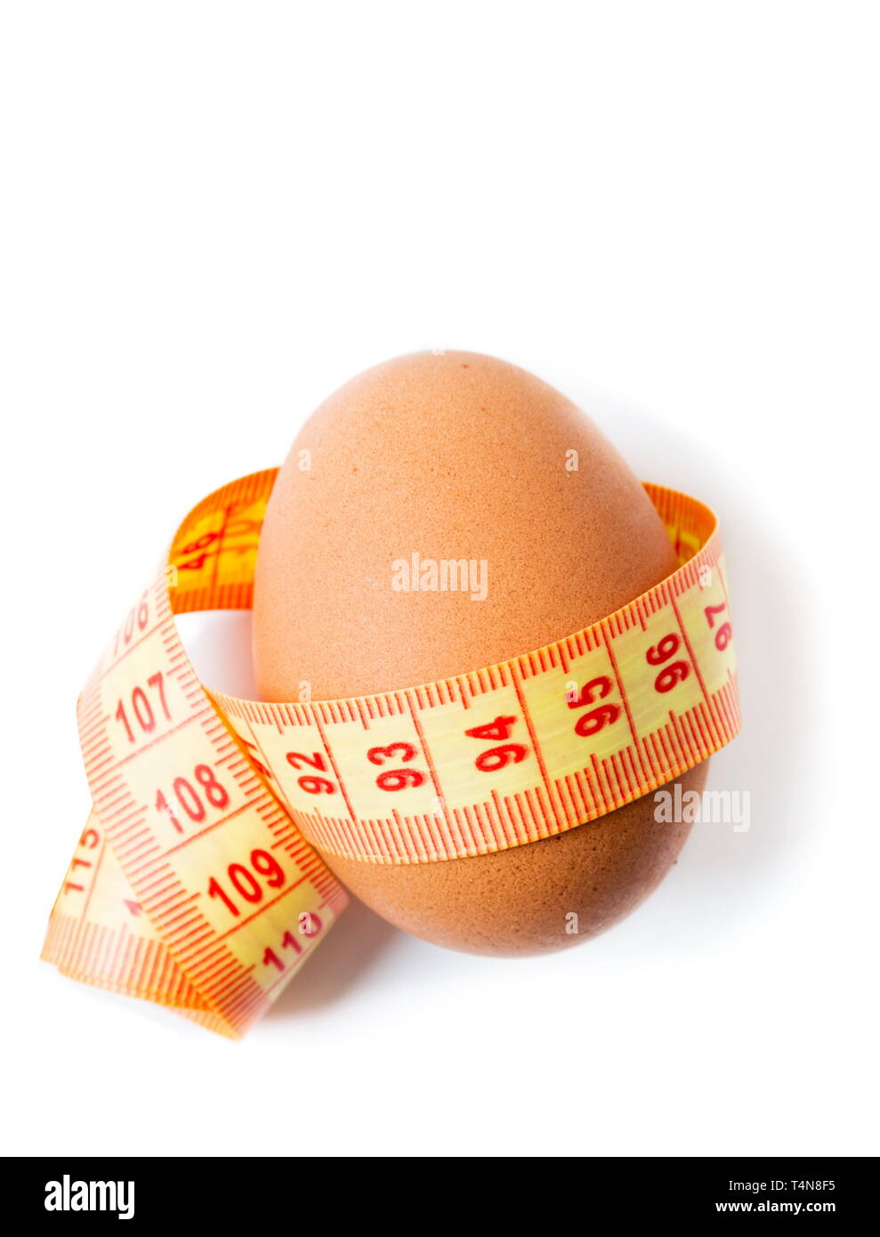 Eggs with the diet meter on the white - Stock Image