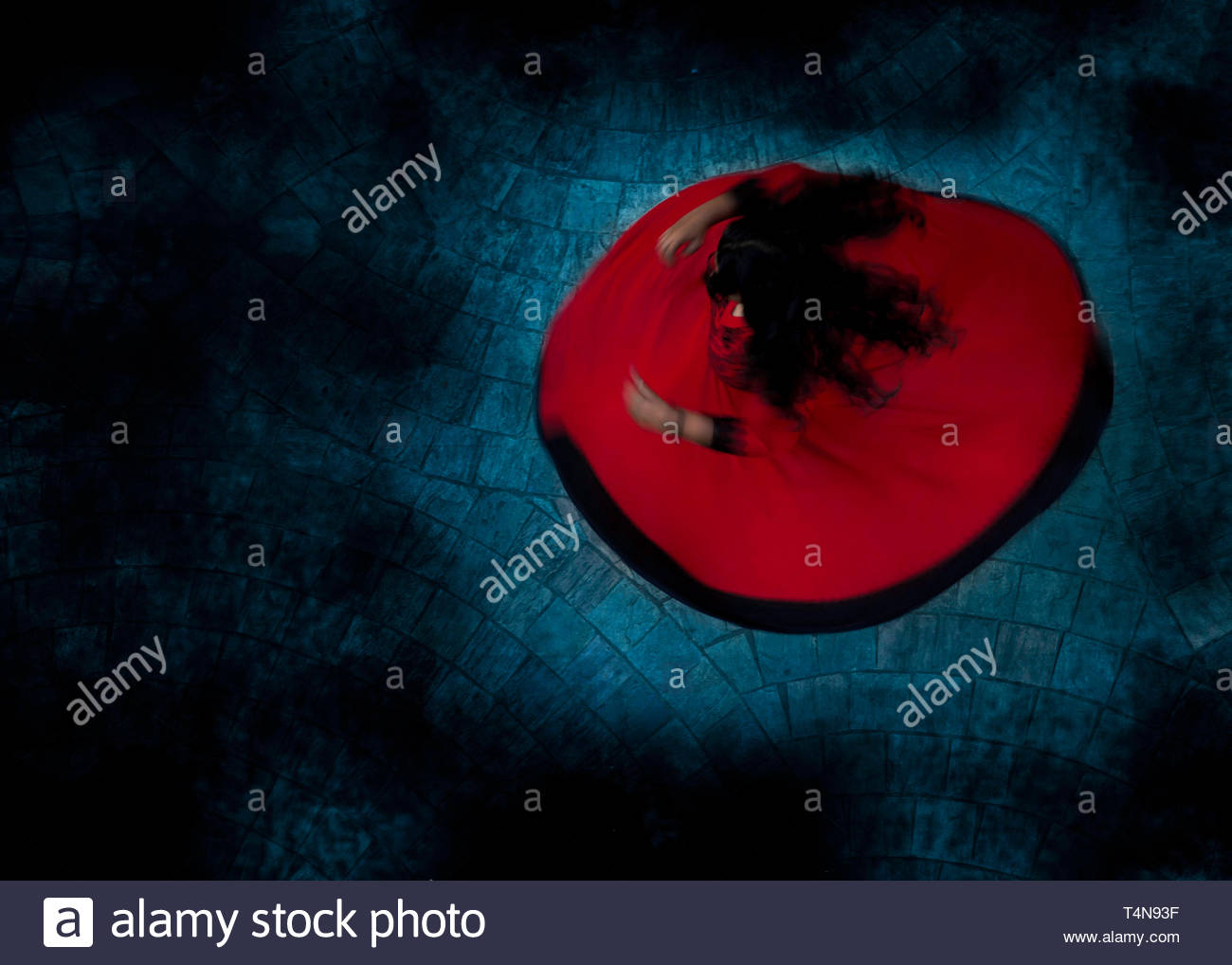 low-light photo of woman in red dress Stock Photo