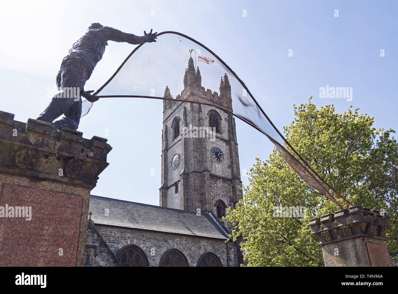 St Andrew the Fisherman sculpture at entrance gates to St Andrew's Church Plymouth - Stock Image