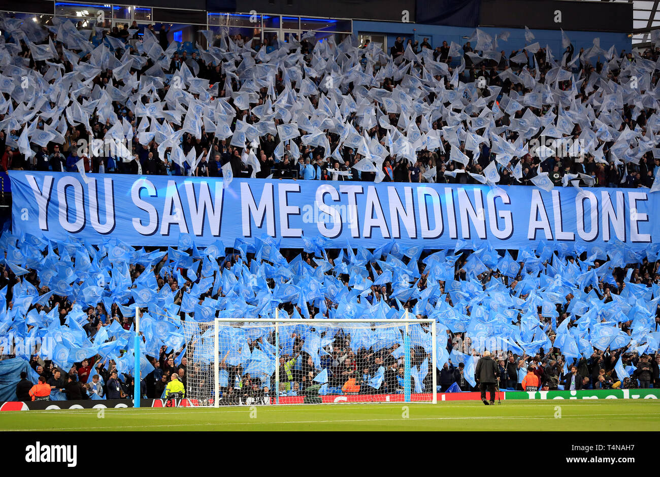 Manchester City fans wave flags ahead of kick-off near a