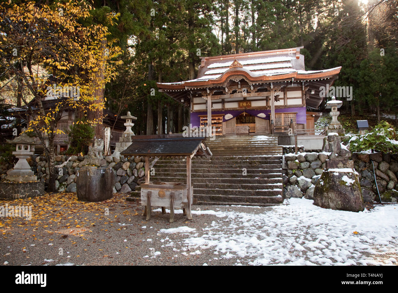 First snow of the year melts at the Shirakawa Hachiman shrine, Shirakawa-go village, Japan and featured in the anime Higurashi When They Cry - Stock Image