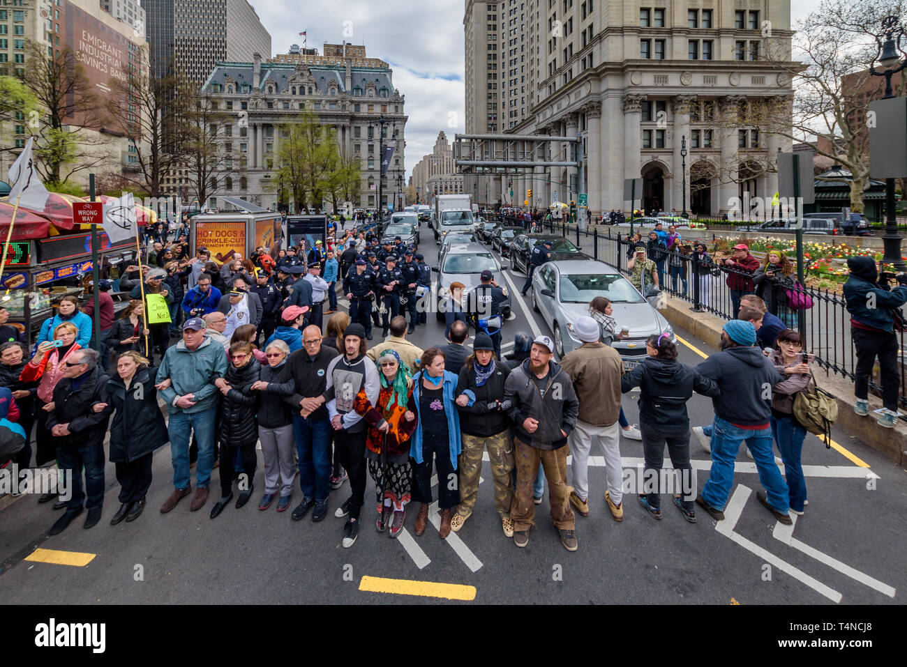 """New York, USA. 17th Apr, 2019. New York, United States. 17th Apr, 2019. Activists from Extinction Rebellion New York City (XR-NYC) engaged in nonviolent direct action to confront climate change outside City Hall on April 17, 2019, demanding a declaration of Climate Emergency and the pursuit of policies to reach zero emissions in the city by 2025. The Extinction Rebellion (XR) movement held similar actions in 38 cities in the U.S. and 49 countries globally, during """"International Rebellion Week"""". Credit: Erik McGregor/Pacific Press/Alamy Live News Stock Photo"""