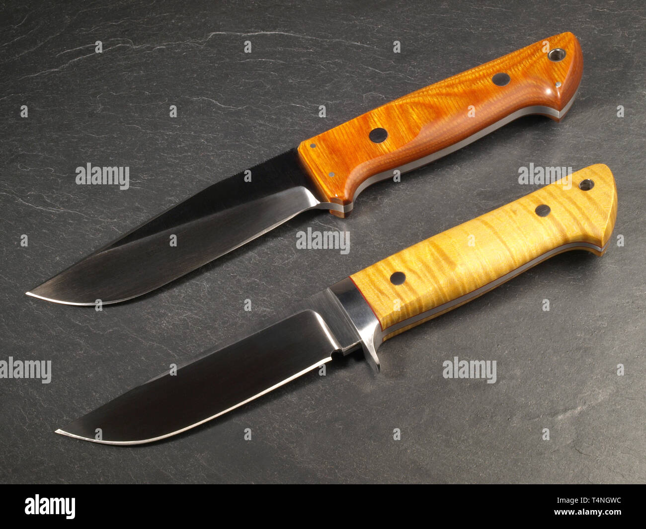 Unique Hunting Knives on Slate Background Stock Photo