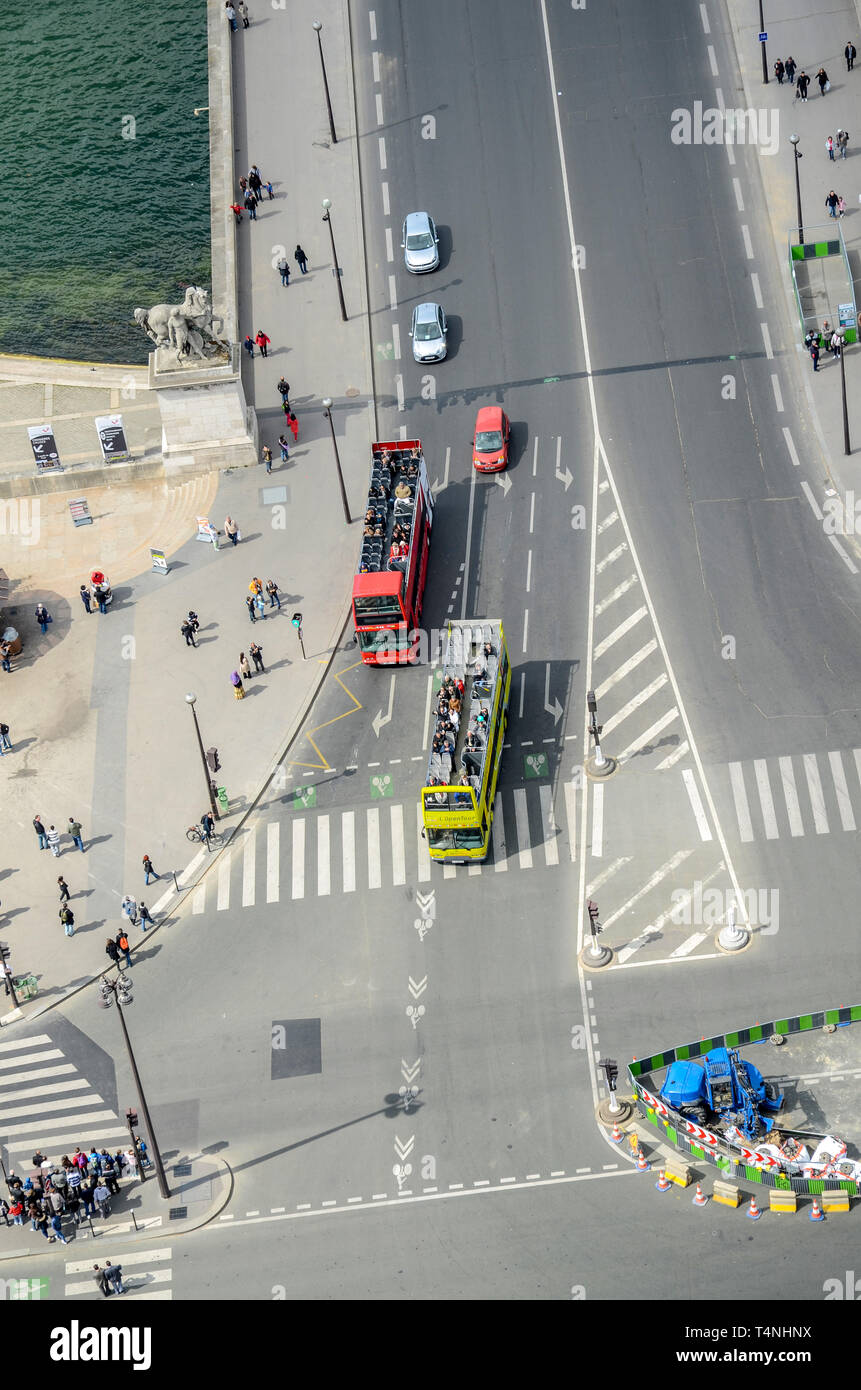 Tourist tour buses at the junction of Pont d'lena and Quai Branly viewed from above from the Eiffel Tower. Aerial view Stock Photo