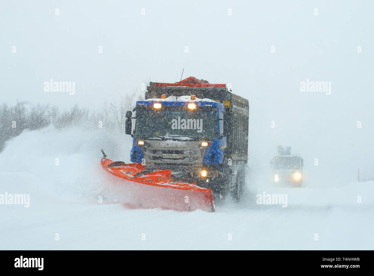 MURMANSK REGION, RUSSIA - FEBRUARY 21, 2019: Clearing the Murmansk-Teriberka road during a snow storm - Stock Image