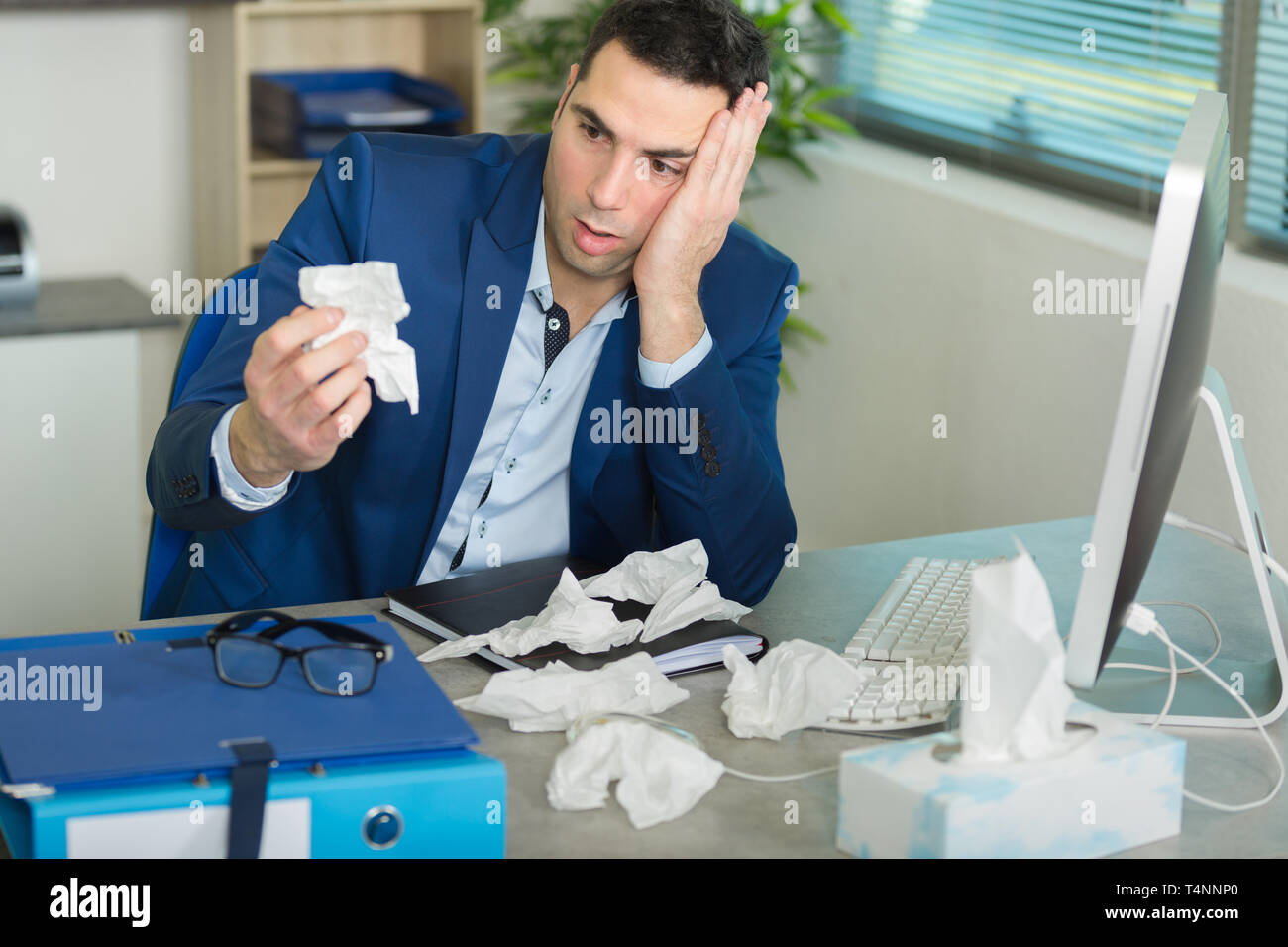 sad man in the office - Stock Image
