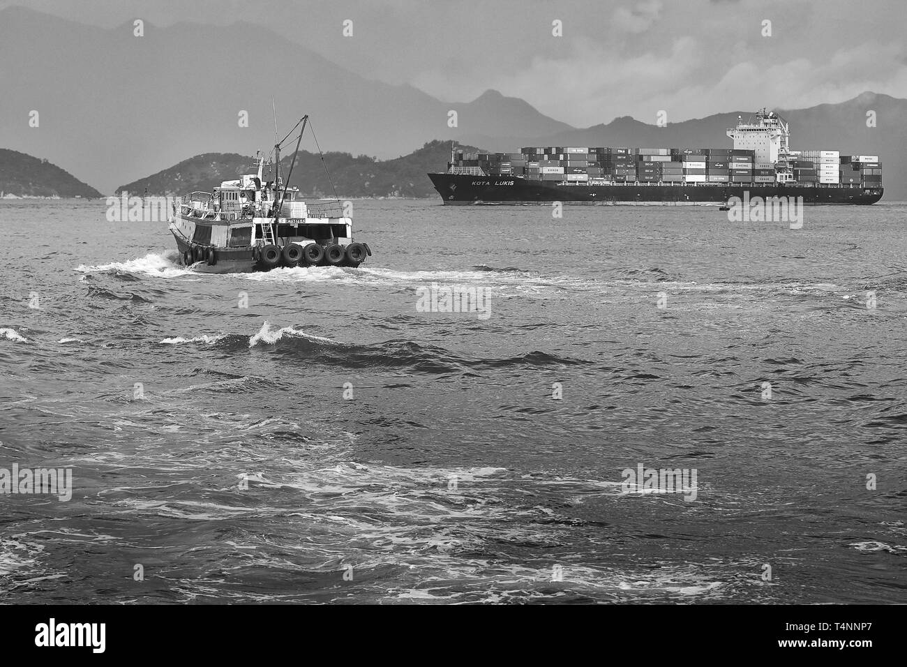 Container Ship KOTA LUKIS, Leaves The Kwai Tsing Container Terminals In Hong Kong And Heads Towards The East Lamma Channel. - Stock Image