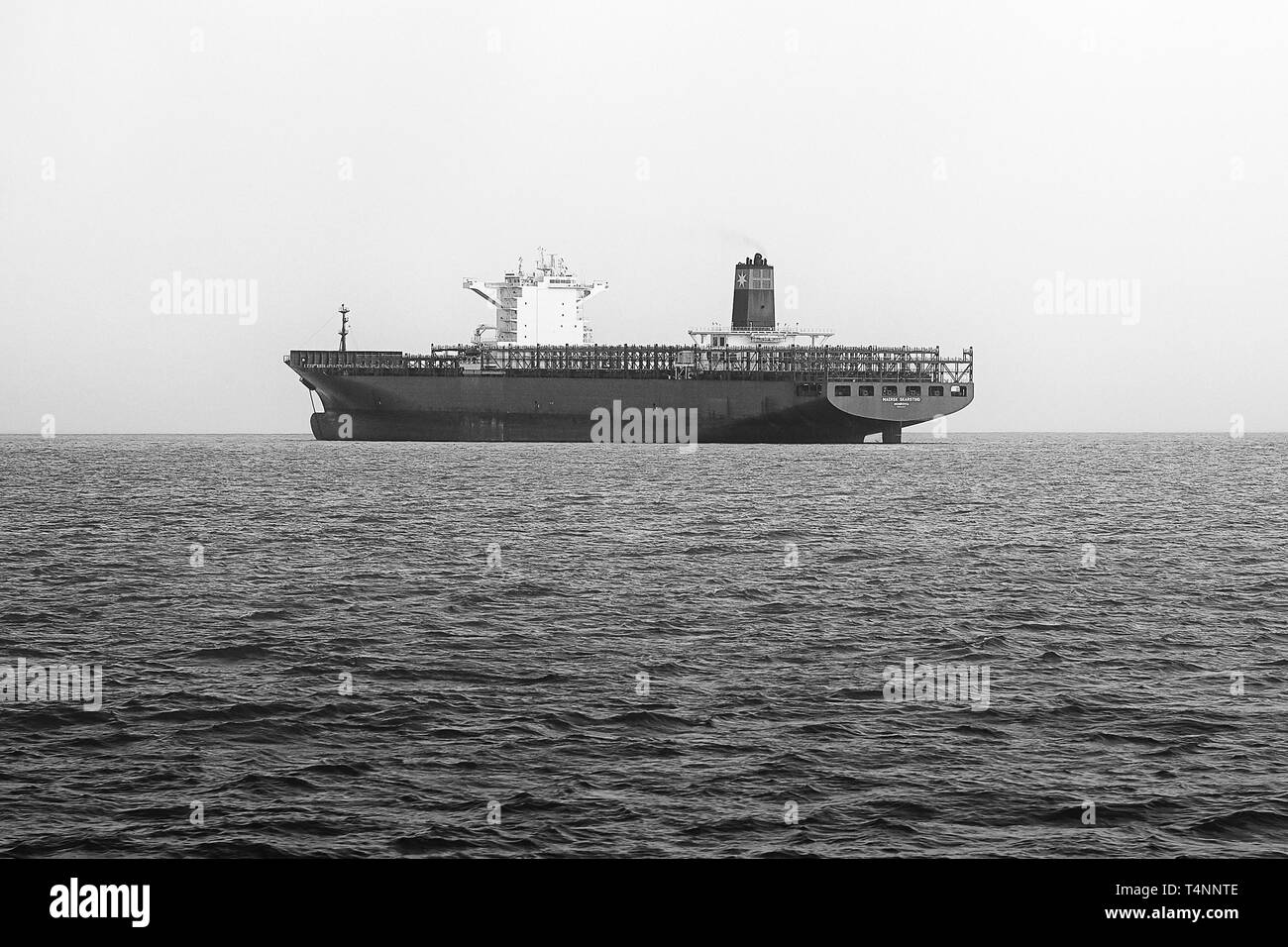 Black and White Photo Of The Empty Container Ship, MAERSK SKARSTIND, Anchored Off Victoria Harbour, Hong Kong. - Stock Image