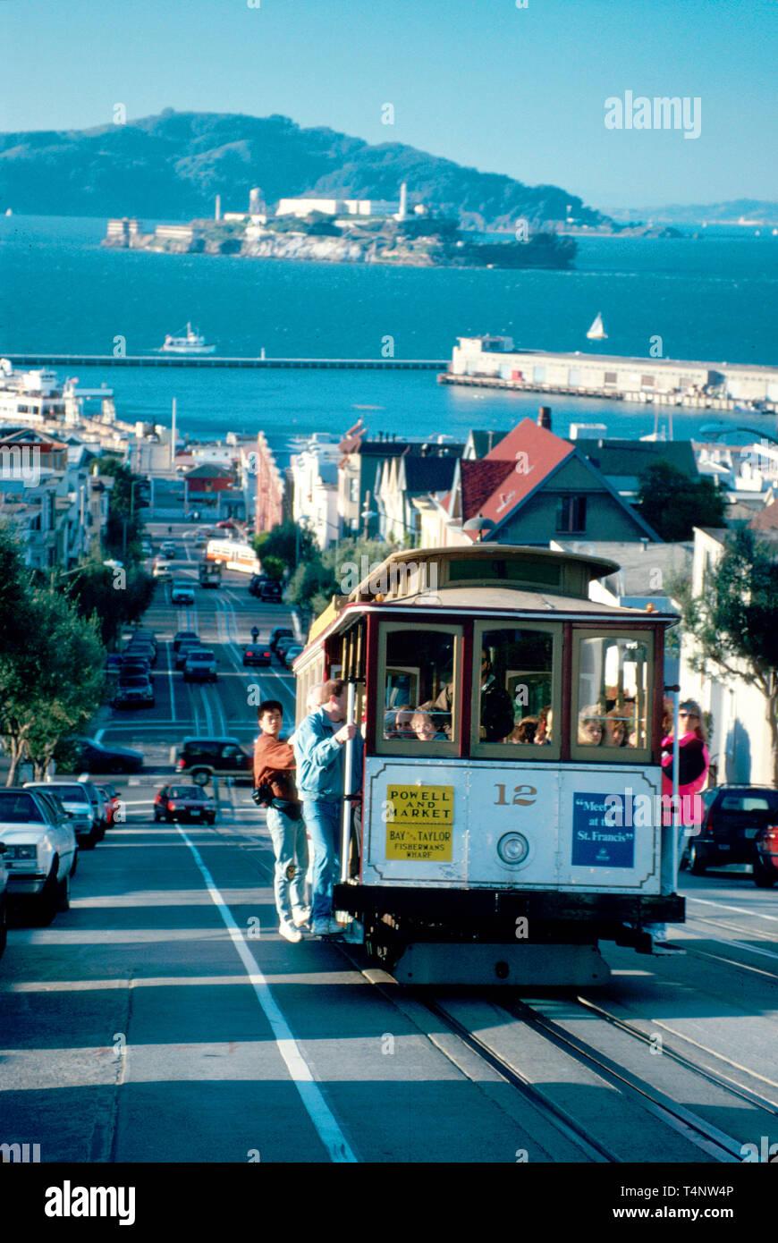 San Francisco California Hyde Street cable car Alcatraz beyond - Stock Image