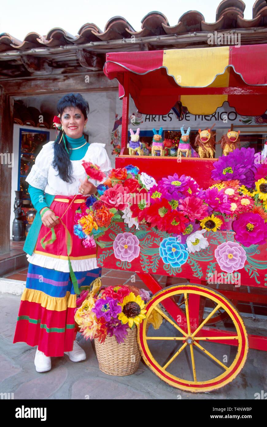 California San Diego Old Town Bazaar del Mundo Mexican woman paper flower kiosk - Stock Image