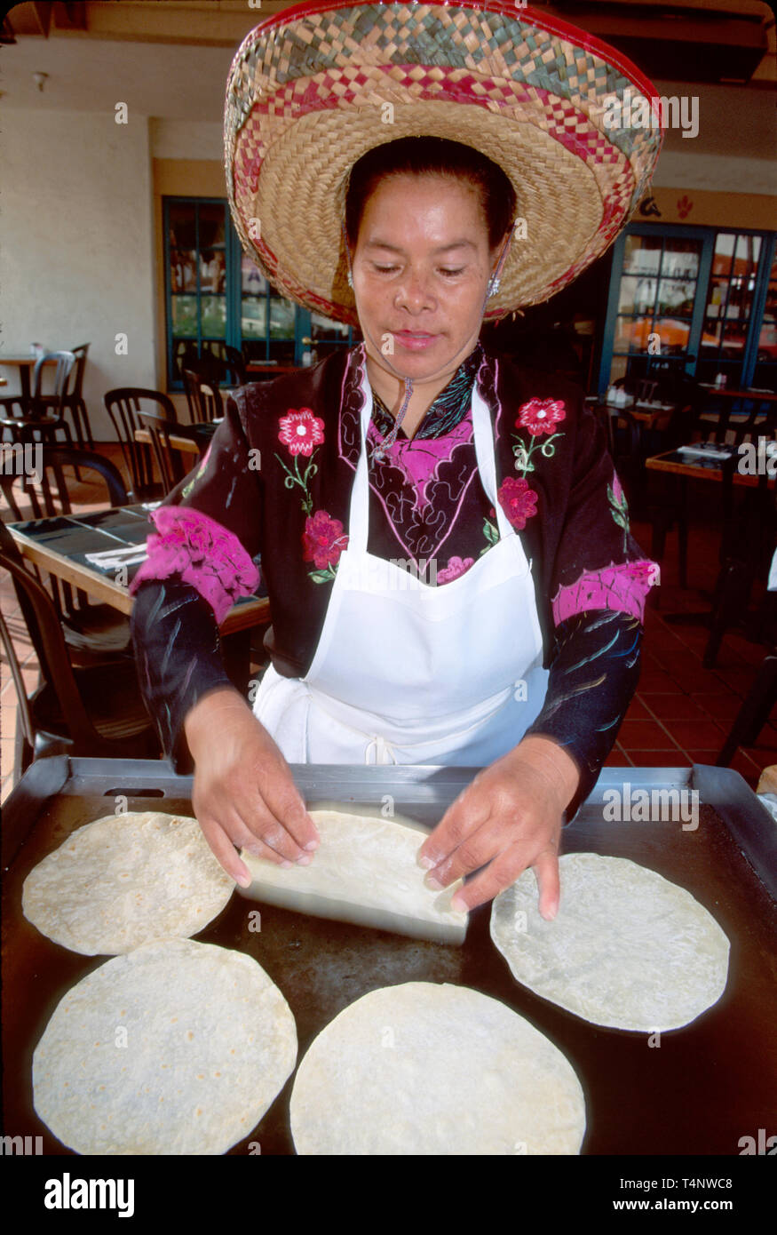 California San Diego Old Town Coyote Cantina cook makes tortillas - Stock Image