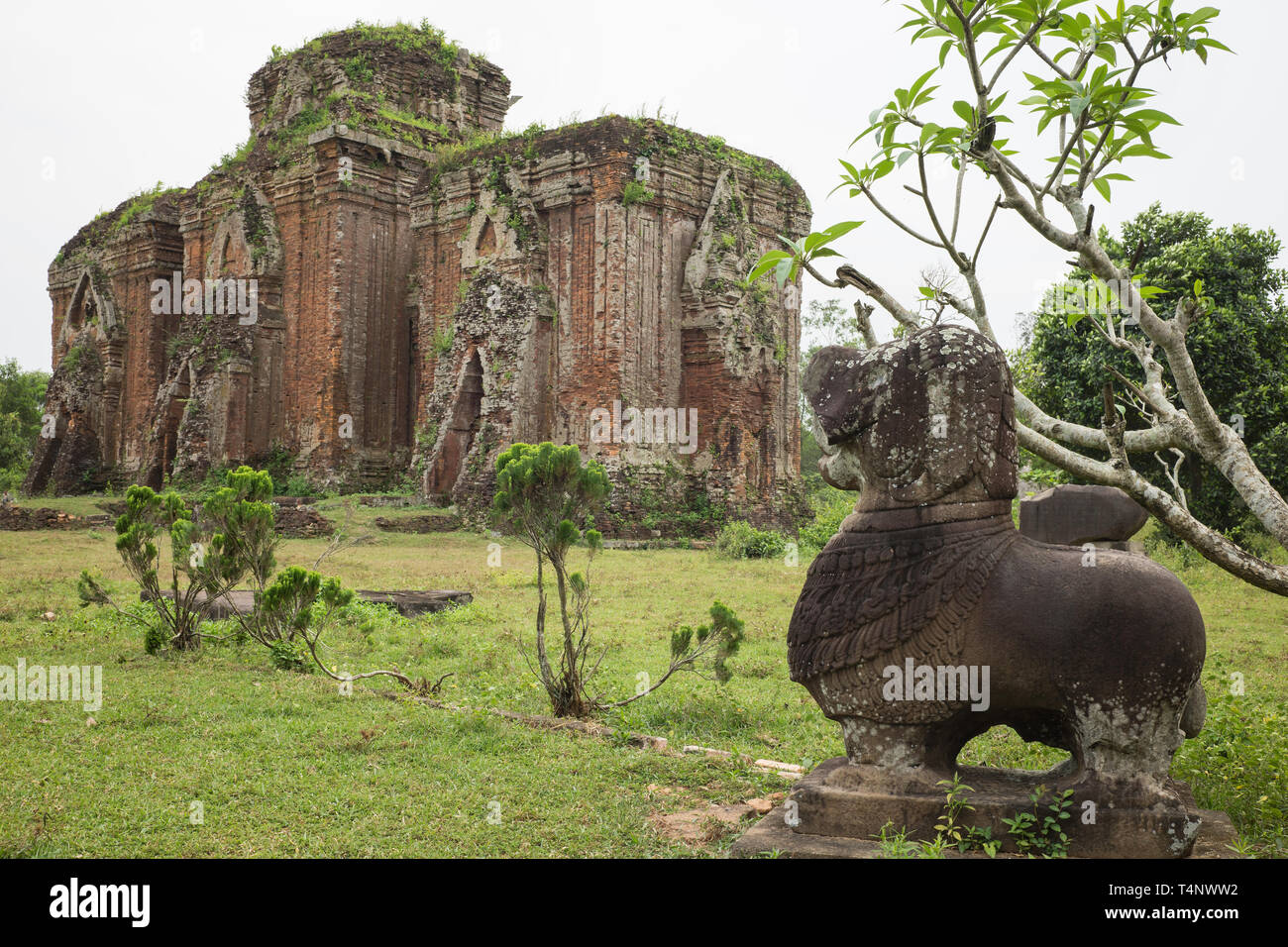 Vietnamese stone dog statue in Chien Dan, Champa ancient tower in Quang Nam, Vietnam - Stock Image