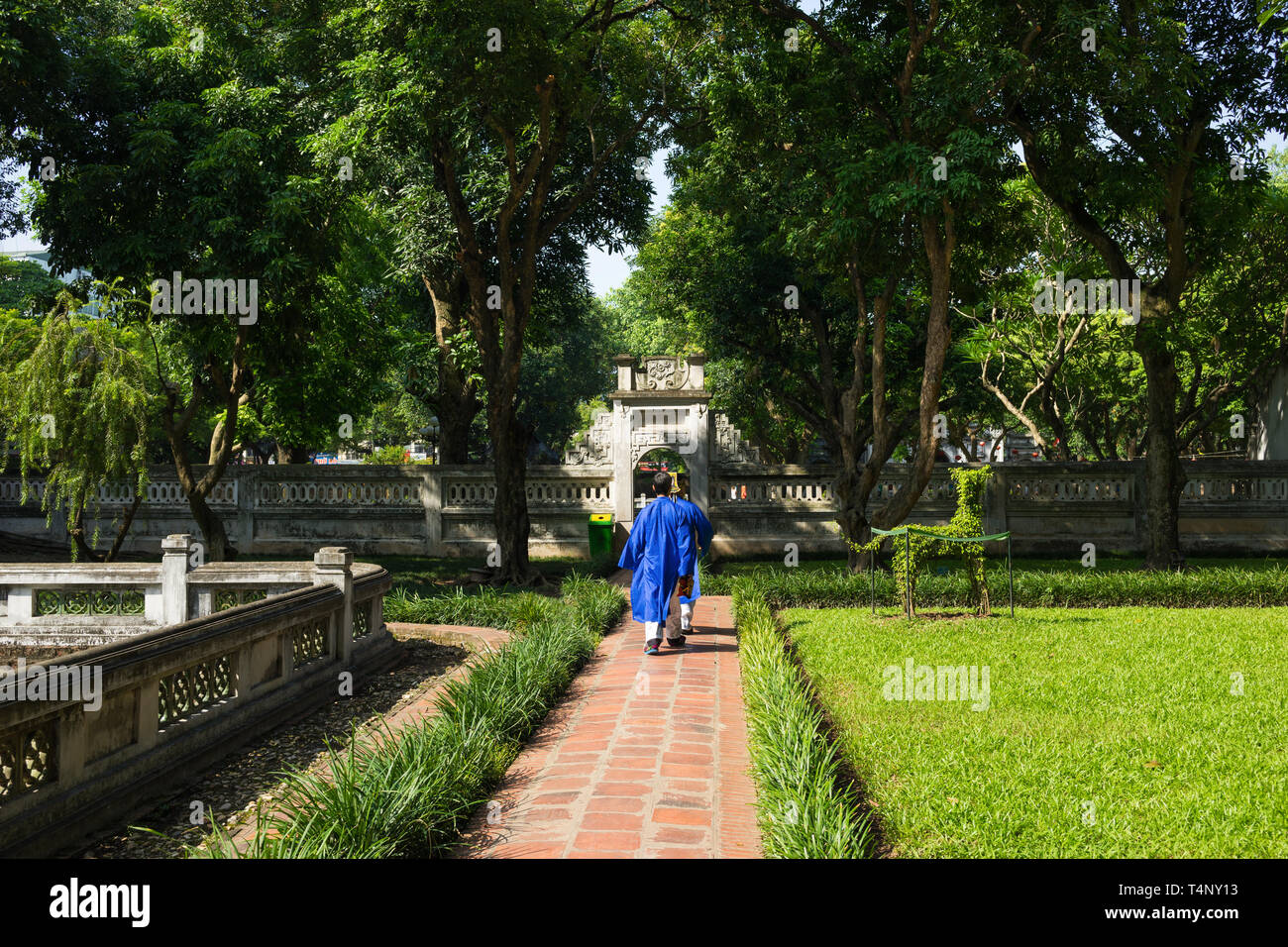 Second Courtyard In Temper Of Literature Or Van Mieu With Two Men Wearing Old Traditional Long Dress Ao Dai Walking On Courtyard Stock Photo Alamy