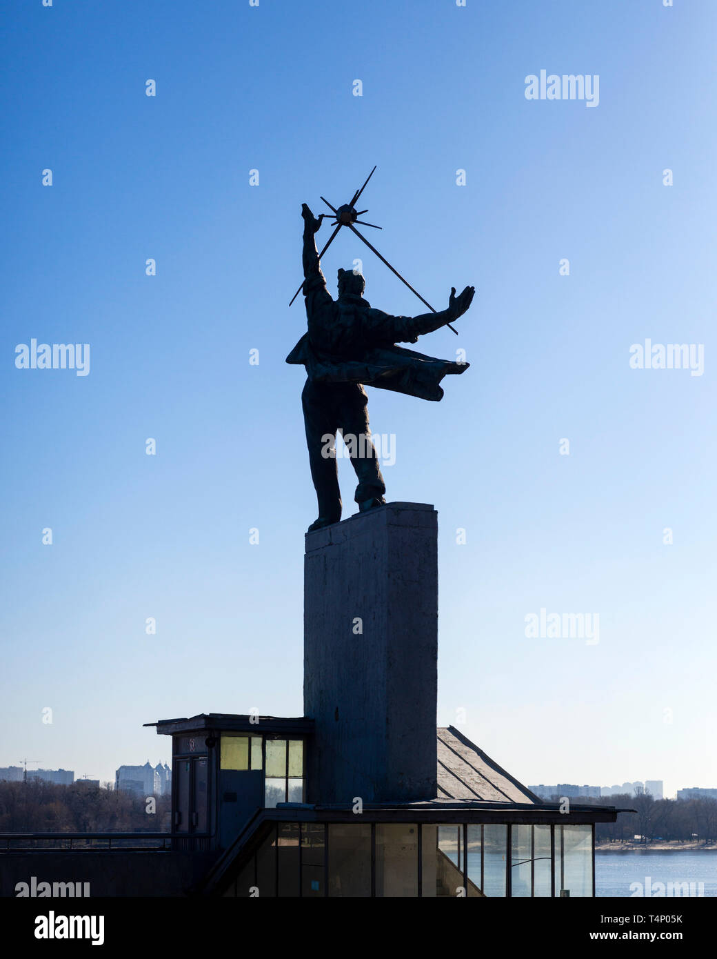 Staircase pavillon with statue of boy holding a Sputnik satellite at Dnipro metro station, Kiev, Ukraine. - Stock Image