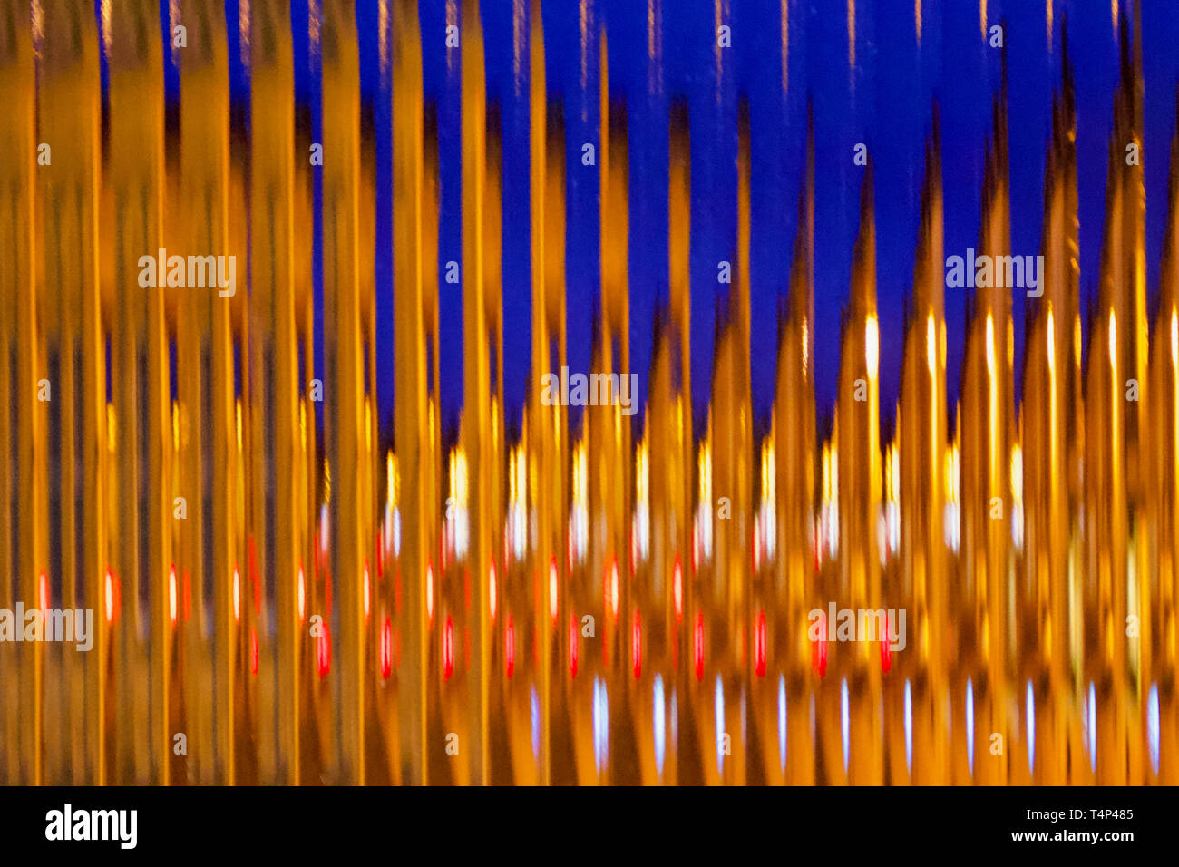 Early morning car lights through an opaque window. - Stock Image