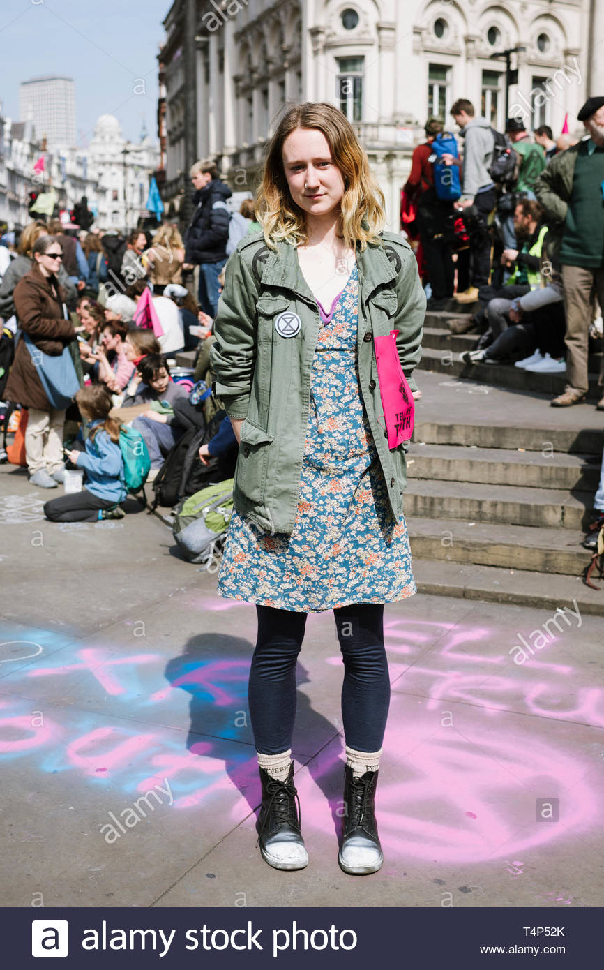 Picadilly Circus, Central London, UK. 15th April 2019. Savannah Lovelock of Extinction Rebellion as demonstrators gather protesting on perceived inact - Stock Image