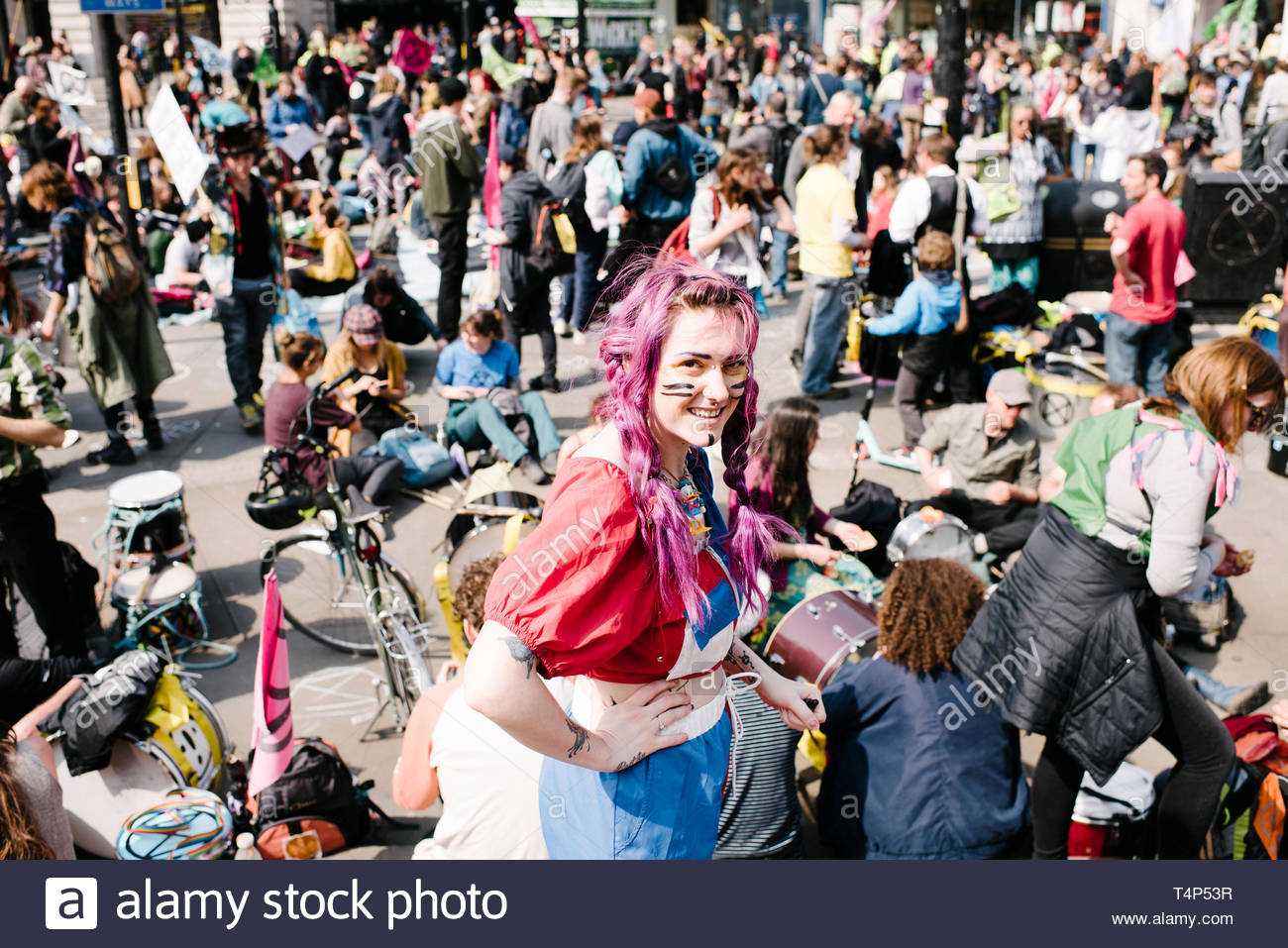 Picadilly Circus, Central London, UK. 15th April 2019. Extinction Rebellion demonstrators protesting on perceived inaction by the government on the en - Stock Image