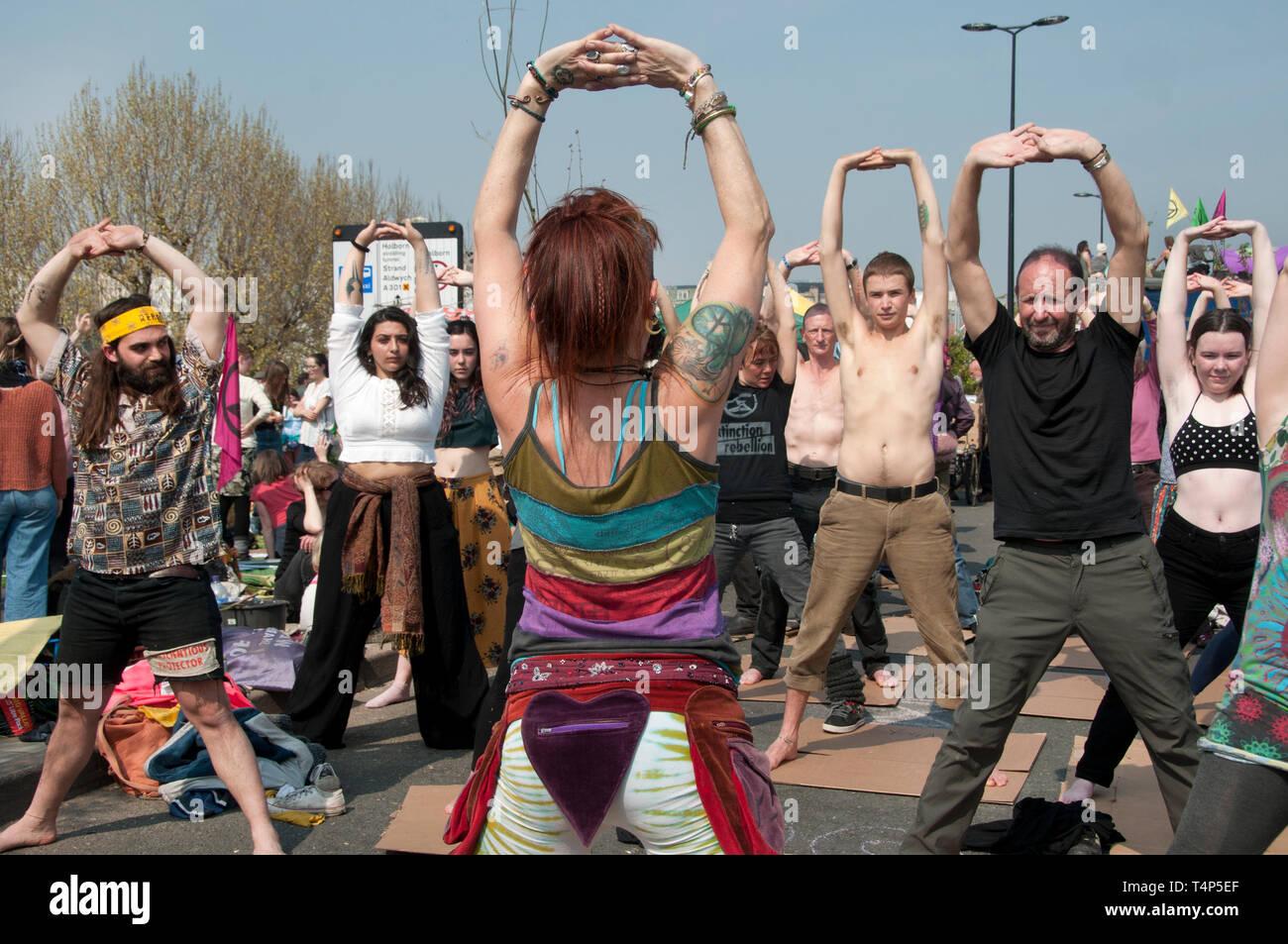 Extinction Rebellion protest, London. April 17th 2019. Waterloo Bridge. Yoga class. Stock Photo