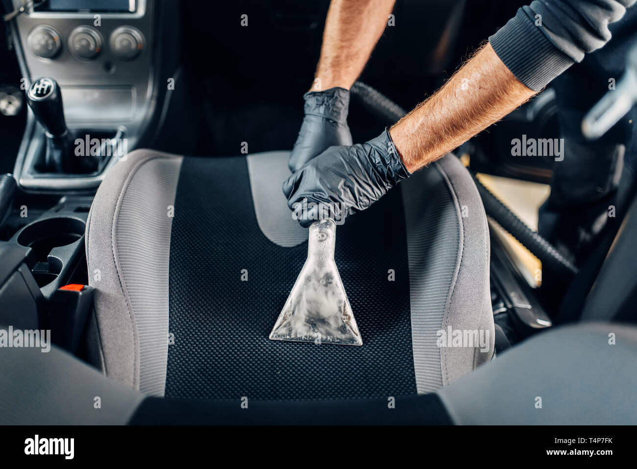 Professional Dry Cleaning Of Car Interior With Vacuum Cleaner