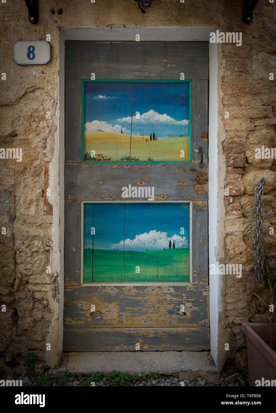 Rustic Door with Tuscan Scenes in the Medieval Fortified Town of  Monteriggioni in Tuscany, Italy - Stock Image