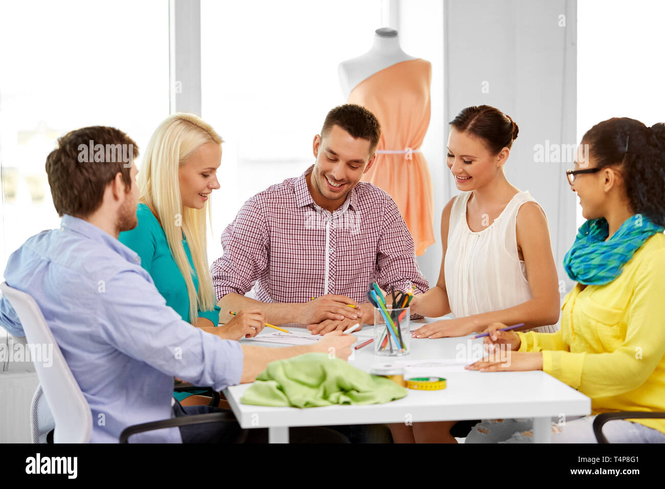 Fashion Design Tailoring And People Concept Team Of Fashion Designers With Sketch Working At Office Stock Photo Alamy