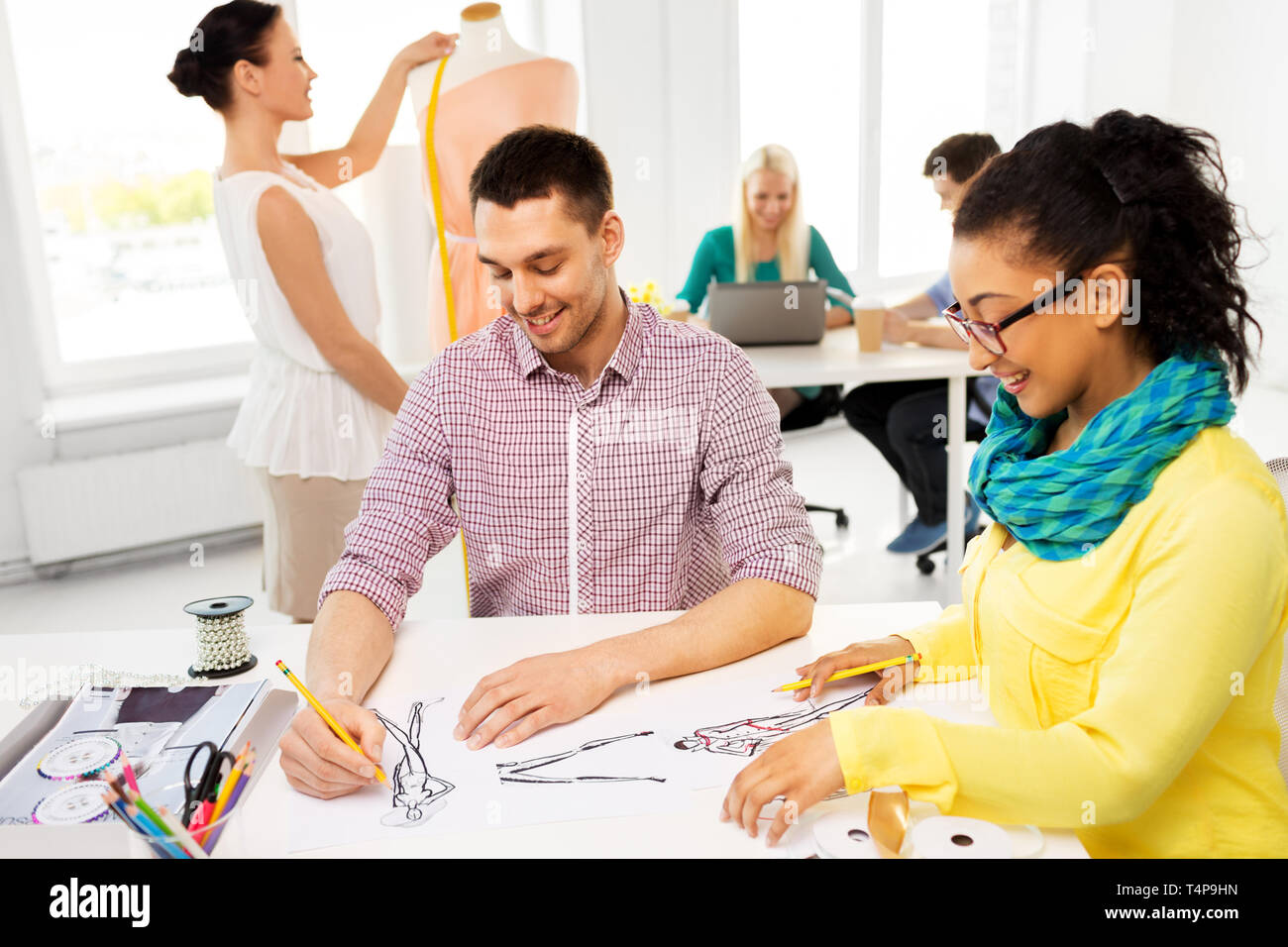 Fashion Design Tailoring And People Concept Team Of Designers Drawing Sketches At Studio Stock Photo Alamy