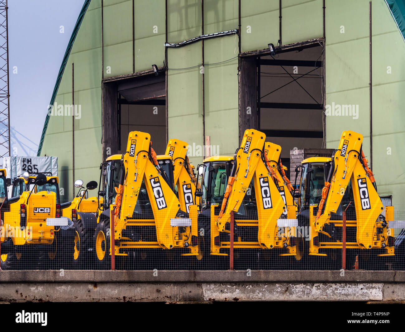 British Exports - JCB diggers or backhoe loaders  ready for export at the port of Harwich in Eastern England. - Stock Image