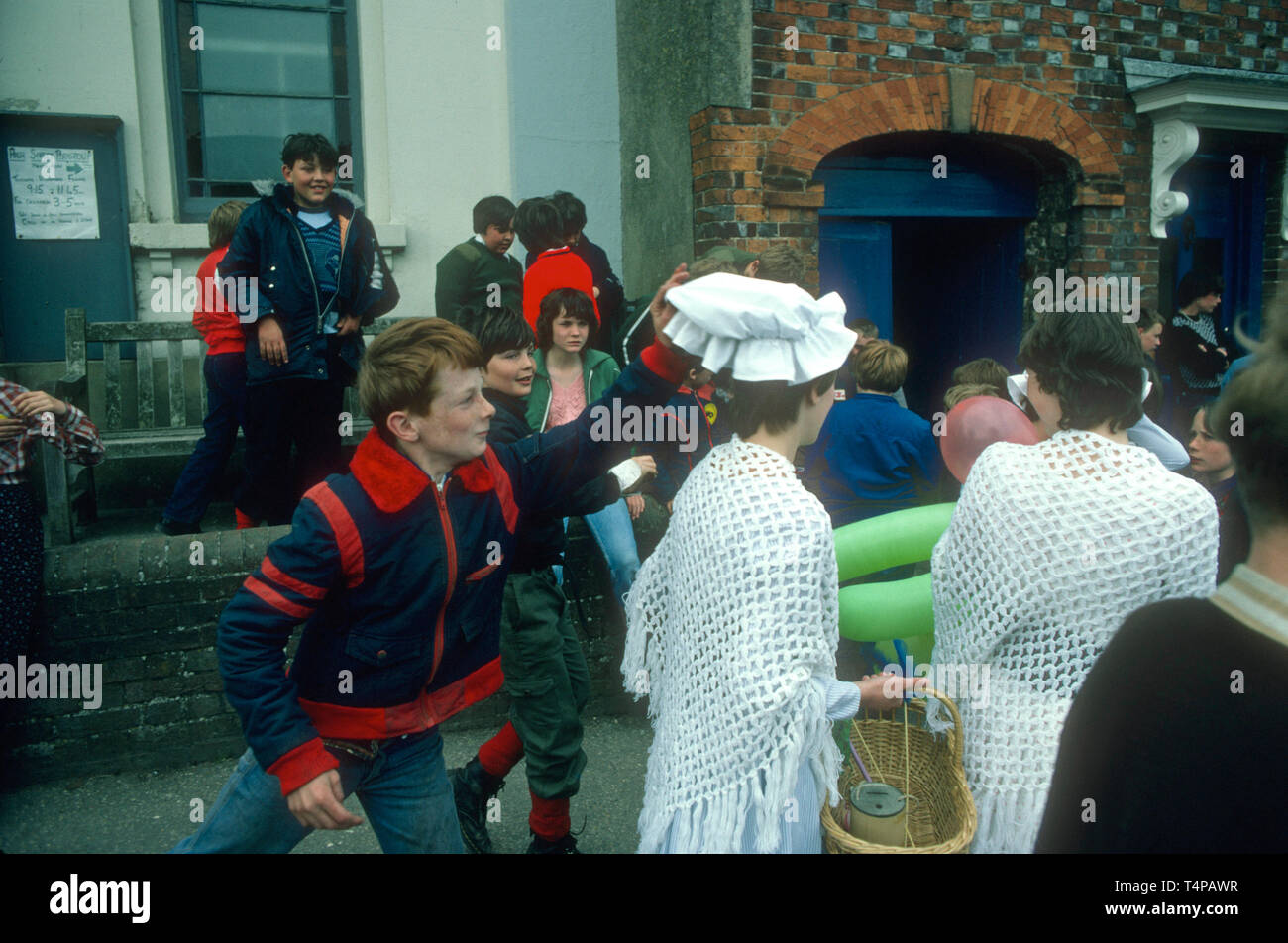 Mischievous children steal a cap during Hungerford Hocktide, UK in 1982 - Stock Image