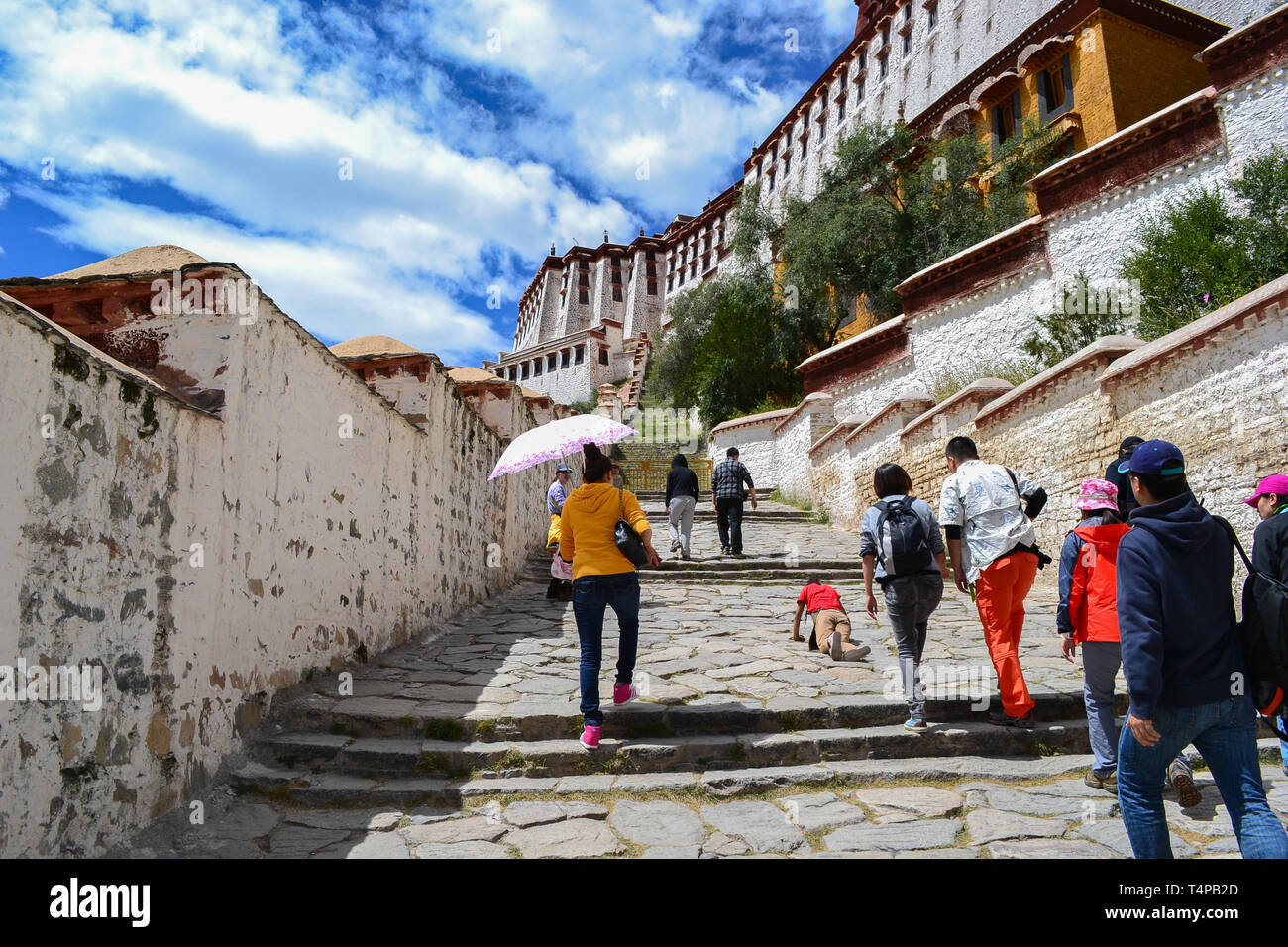People visiting Potala Palace, the original residence of the Dalai Lama and the most important architecture of Tibetan Buddhism in Lhasa, Tibet - Stock Image