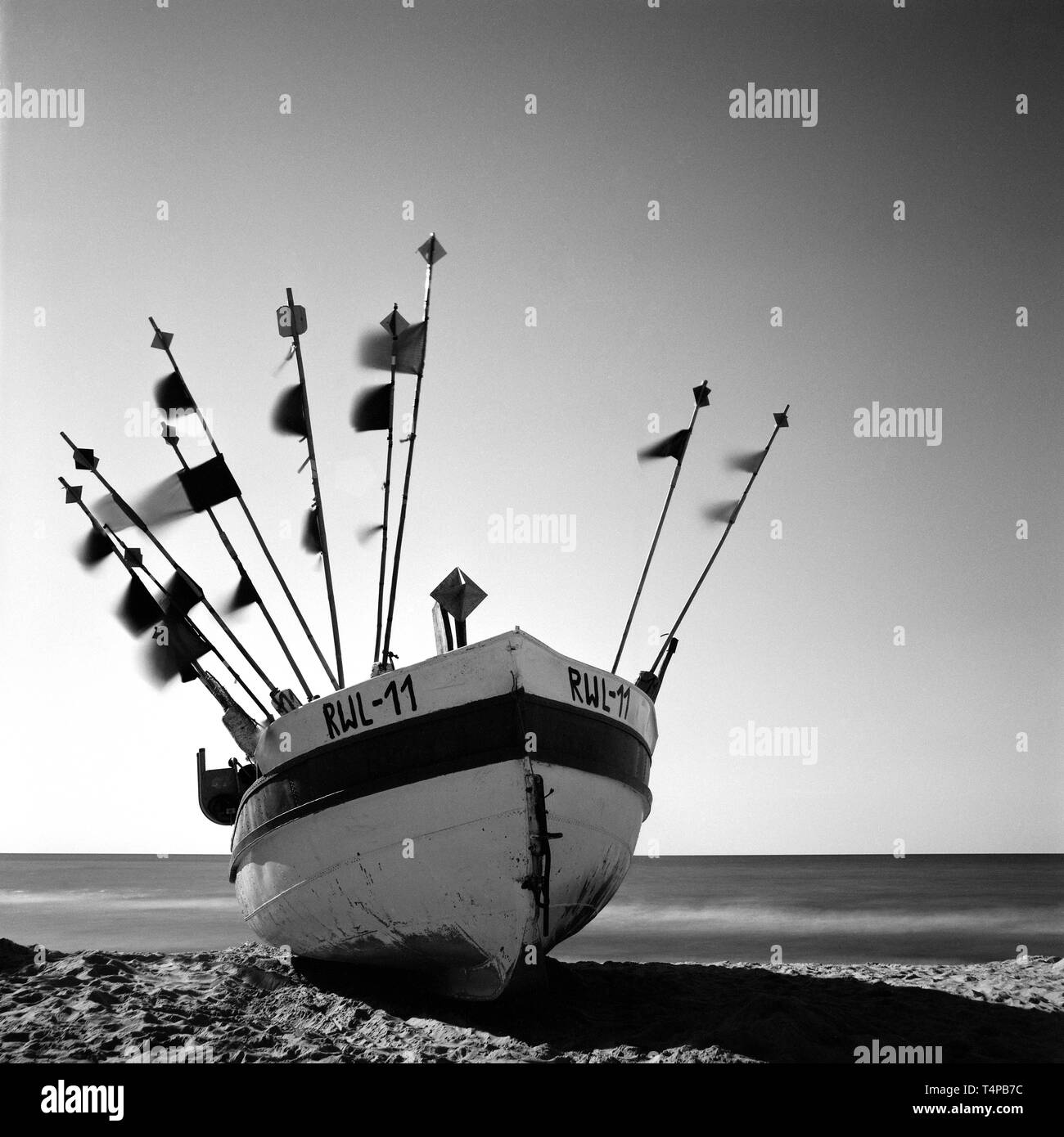 fishing boat on beach in Poland at Baltic sea. finert analog black and white photography. Artwork - Stock Image