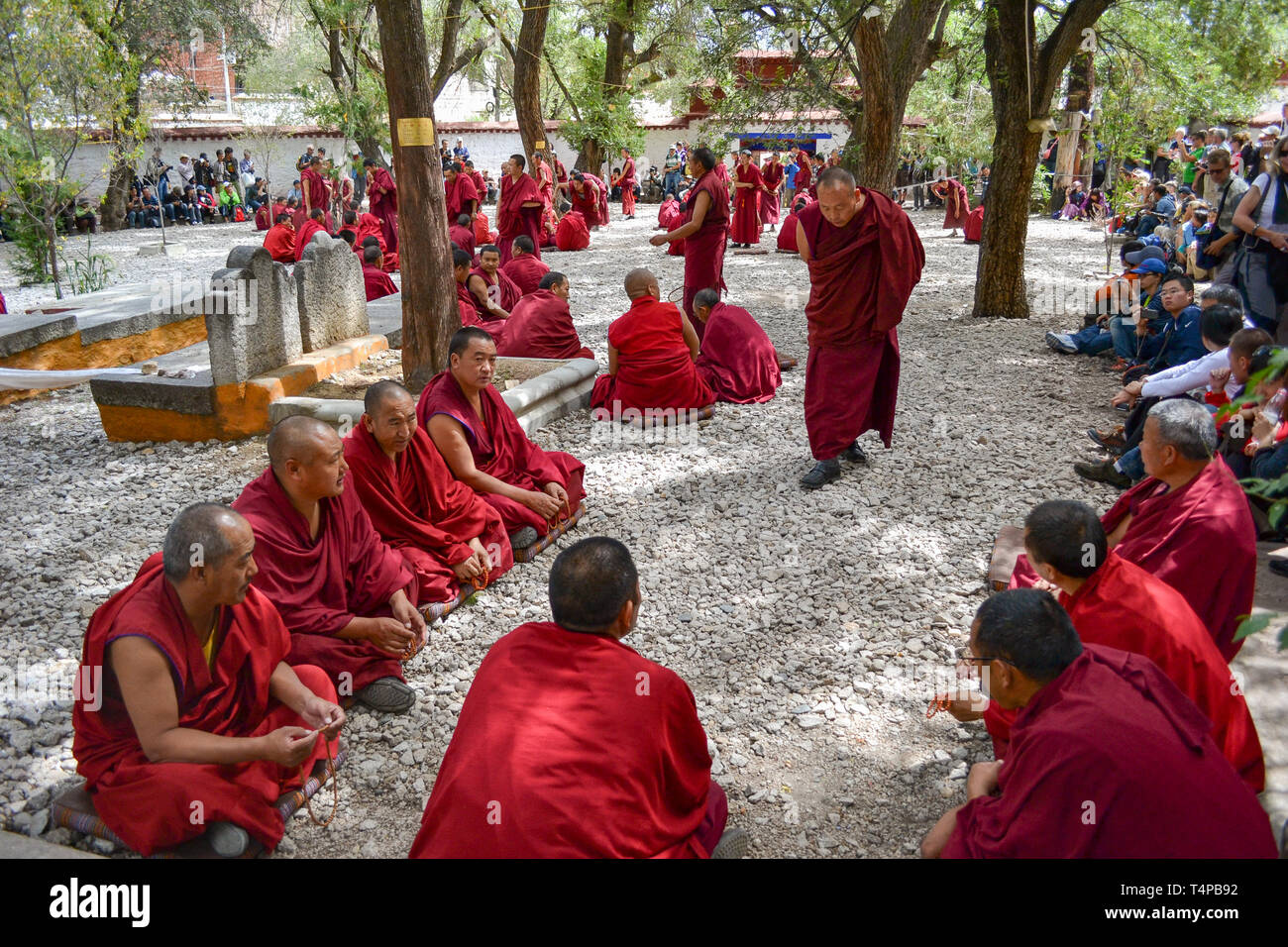 The debates among monks on the Tibetan Buddhism doctrines in Sera Monastery, Lhasa, Tibet - Stock Image