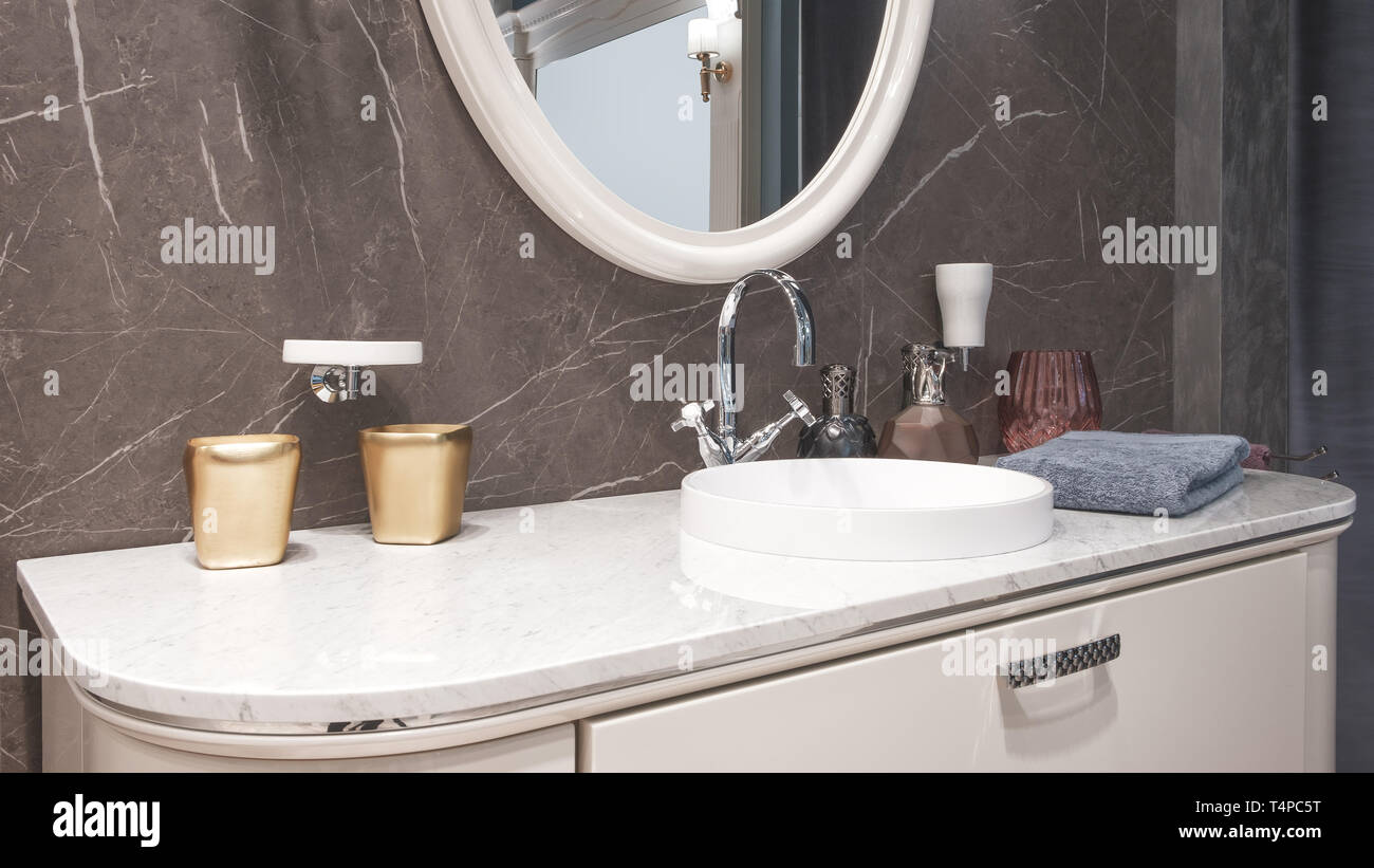 Luxury Modern Big White Faucet Mixer On A Round Sink In A Beautiful Beige Marble Bathroom A Large Round Mirror Stock Photo Alamy