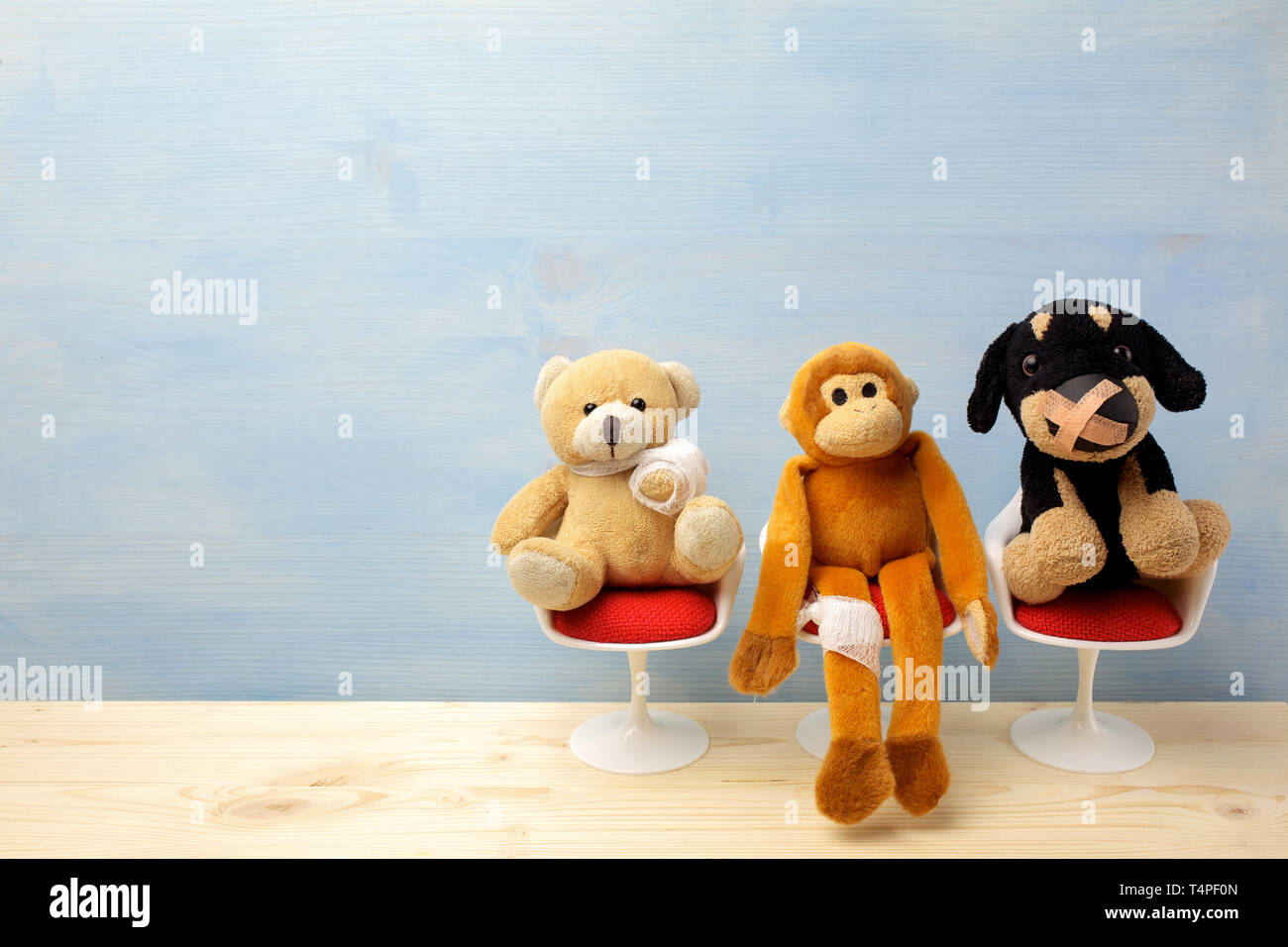 Pediatrician. Toy animals sitting on the chair in hospital. Health center for children. - Stock Image