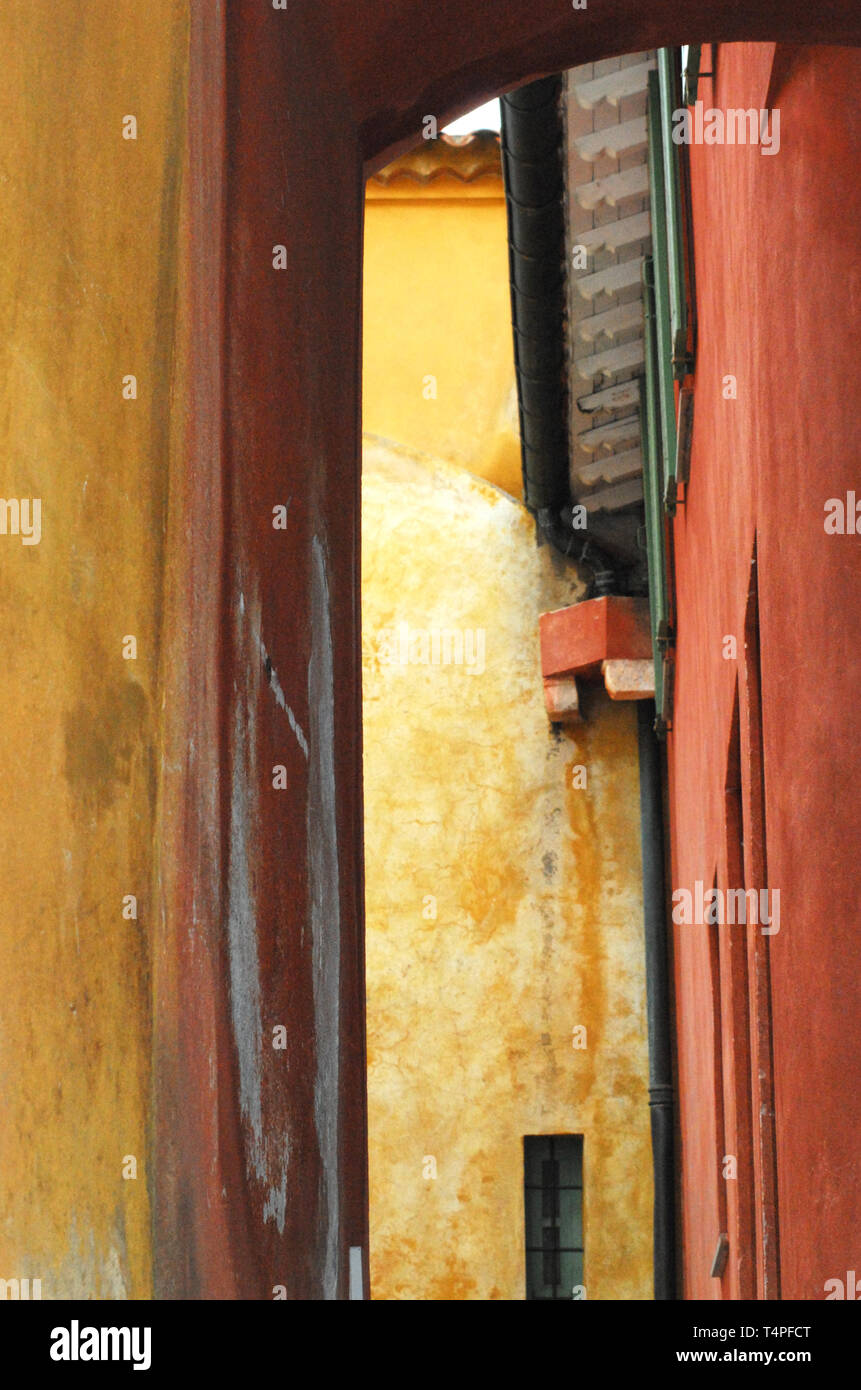 Vertical close up of colorful walls in a narrow street of a typical charming Medieval village in France, Europe. - Stock Image
