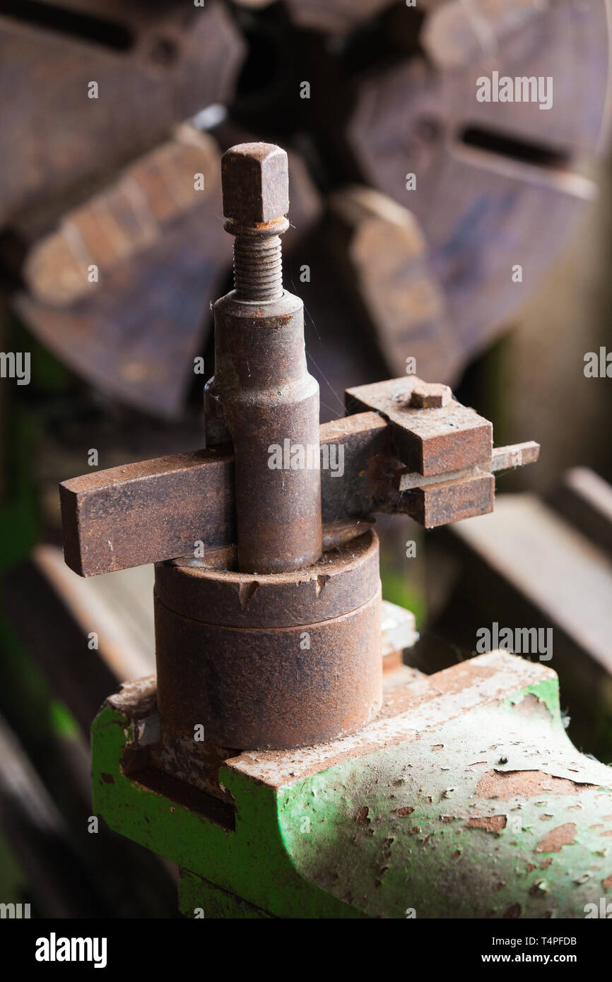 View of an antique tool post on an old model metal lathe - Stock Image