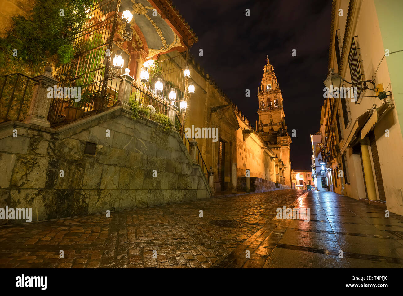 Bell Tower of the Mosque–Cathedral of Córdoba. Image taken from Calle Cardenal Herrero and Calle Céspedes. - Stock Image