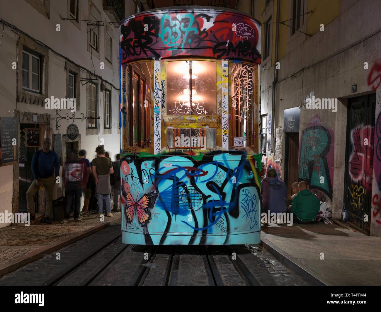 A graffitied cable car (Elevador da Bica) on Rua de Bica de Duarte Belo, Barrio Alto district. Veiw from Lagro Calhariz. Stock Photo