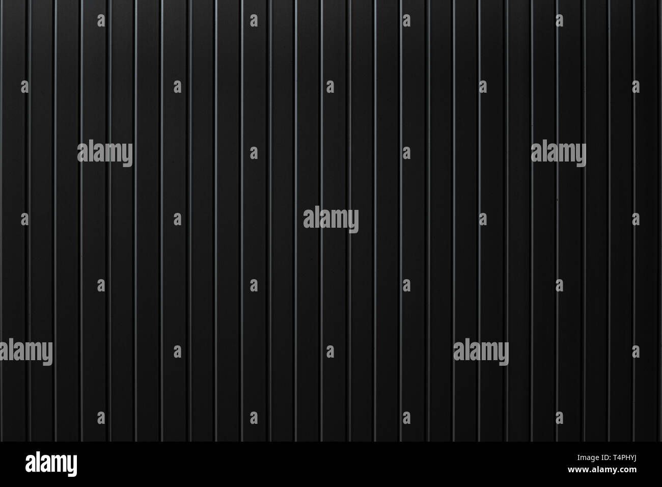 Black metal plate wall, Seamless surface of galvanized steel. Industrial building wall made of corrugated metal sheet, flat background photo texture - Stock Image