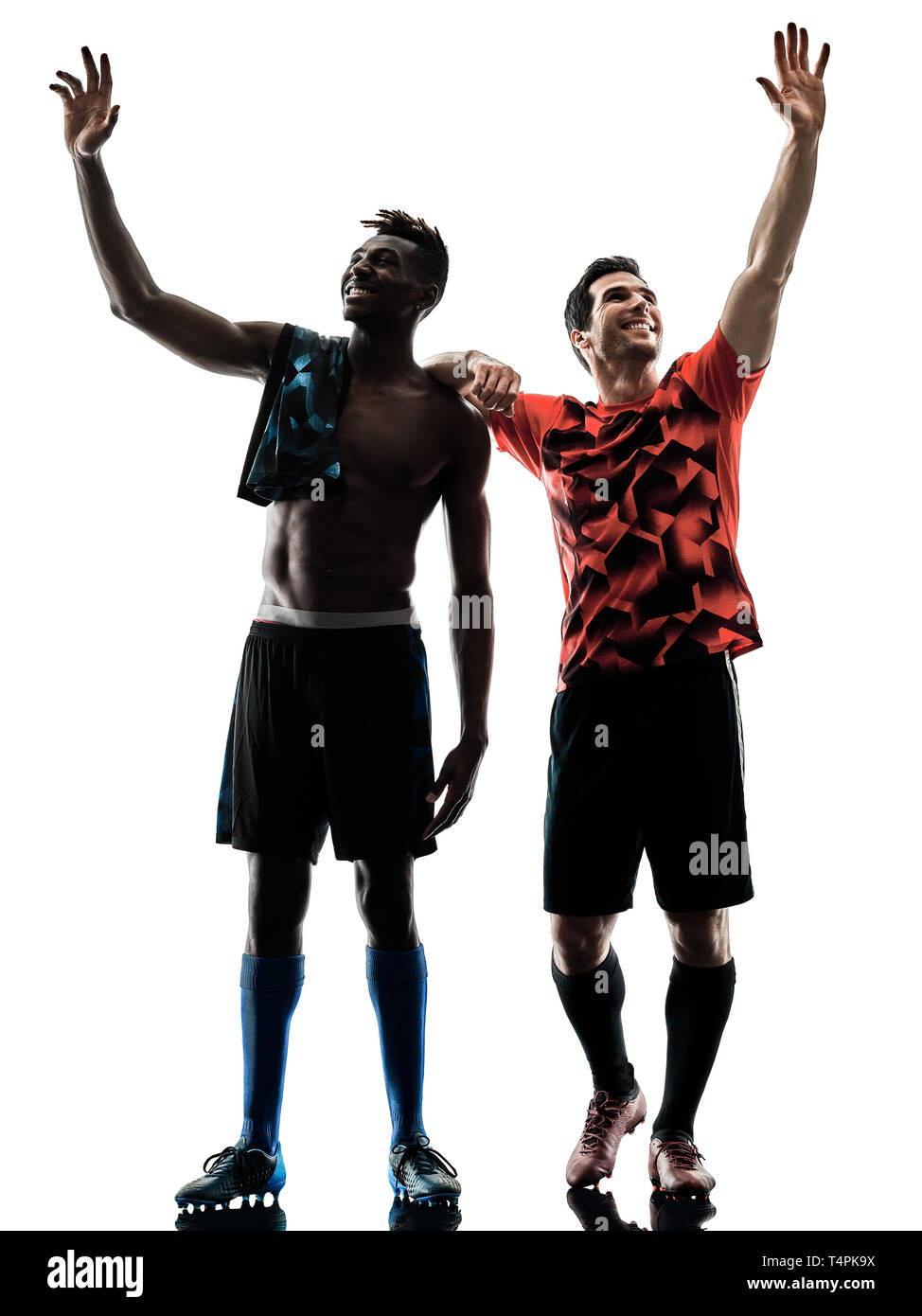 two soccer players men in studio silhouette isolated on white background - Stock Image