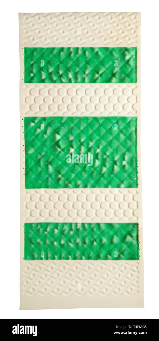 Natural rubber latex mattress with support zones in alternating green and white for maximum support and elasticity viewed from above lying flat on whi - Stock Image
