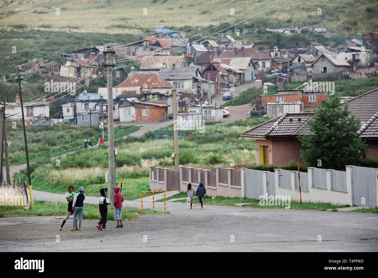Janovce, Slovakia, 15th. February, 2019 : Gipsy's part of the village on eastern Slovakia during rainy day, children - Stock Image