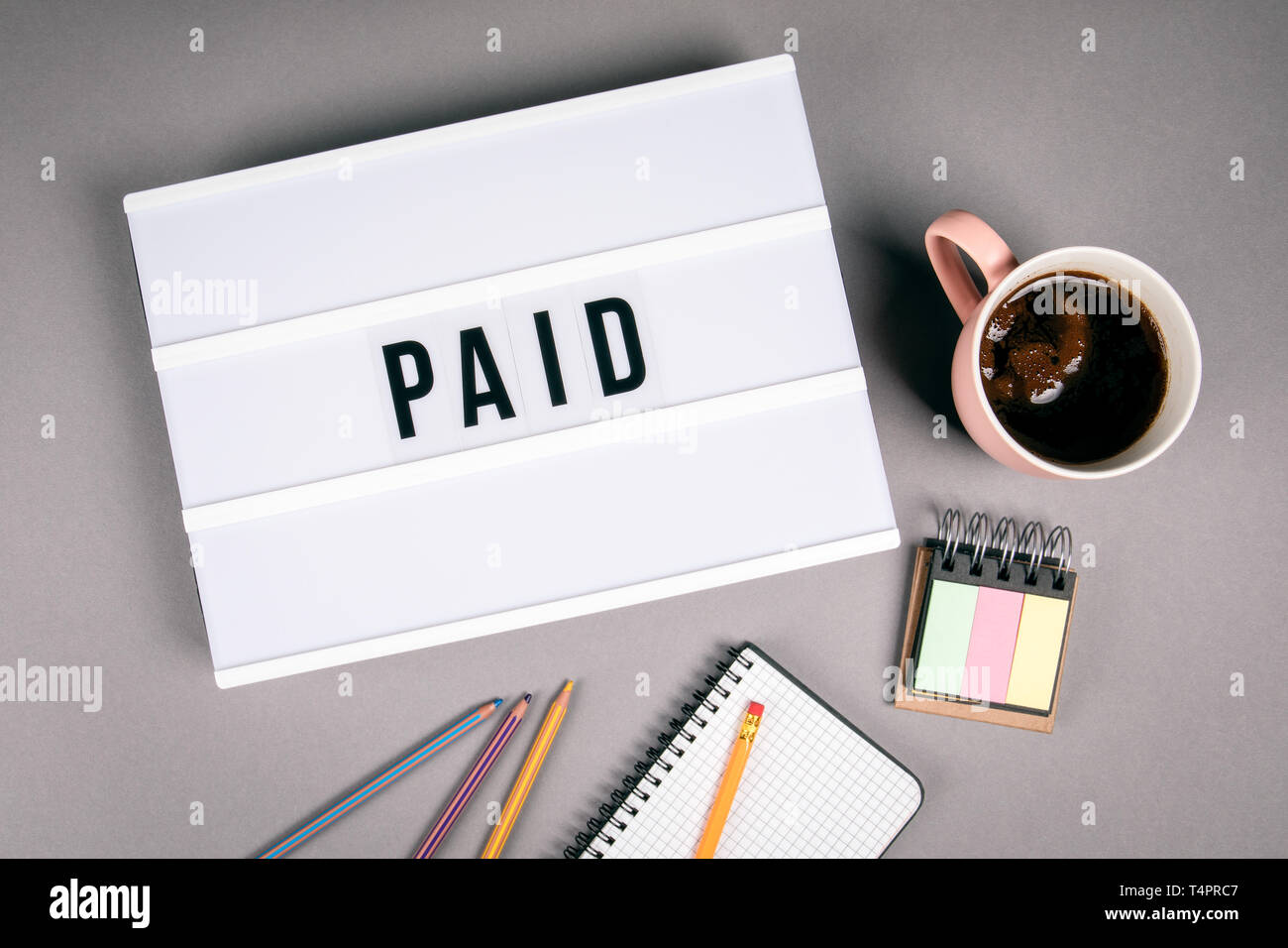 Paid. Text in light box - Stock Image