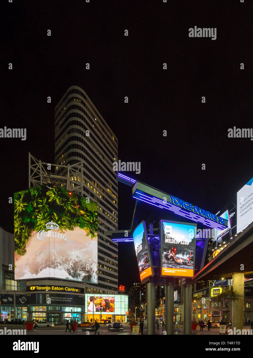 The neon lights and bright LED signs of Yonge-Dundas Square (Dundas Square) and the Eaton Centre at night in downtown Toronto, Ontario, Canada - Stock Image