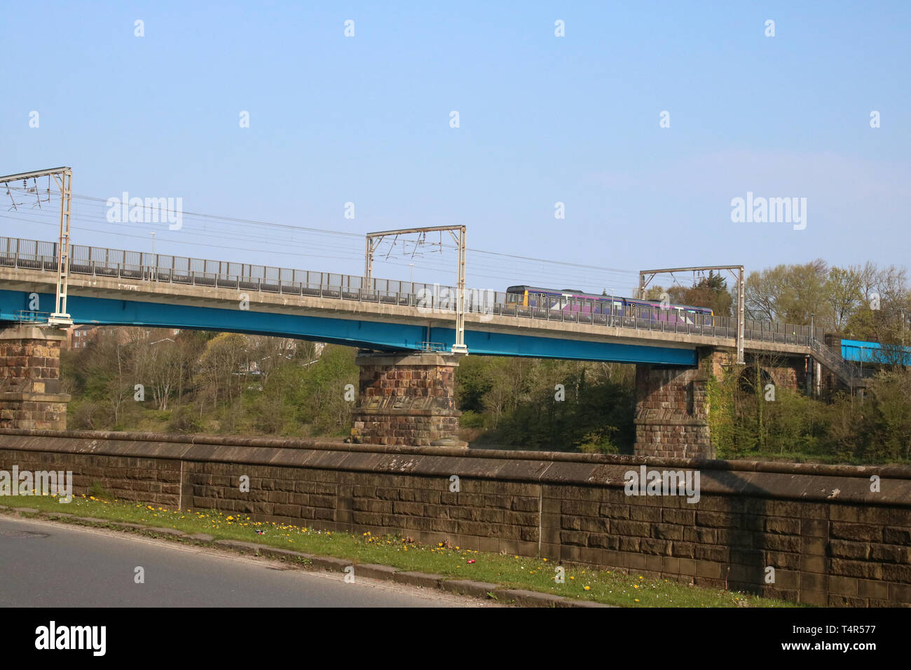 Two car Pacer diesel multiple unit train in Northern livery crossing Carlisle Bridge over the River Lune in Lancaster with local train 17th April 2019. - Stock Image