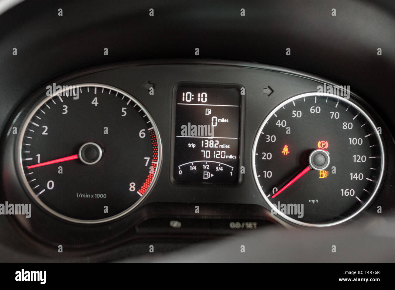 driving on empty fuel tank - fuel gauge showing 0 miles to empty Stock Photo