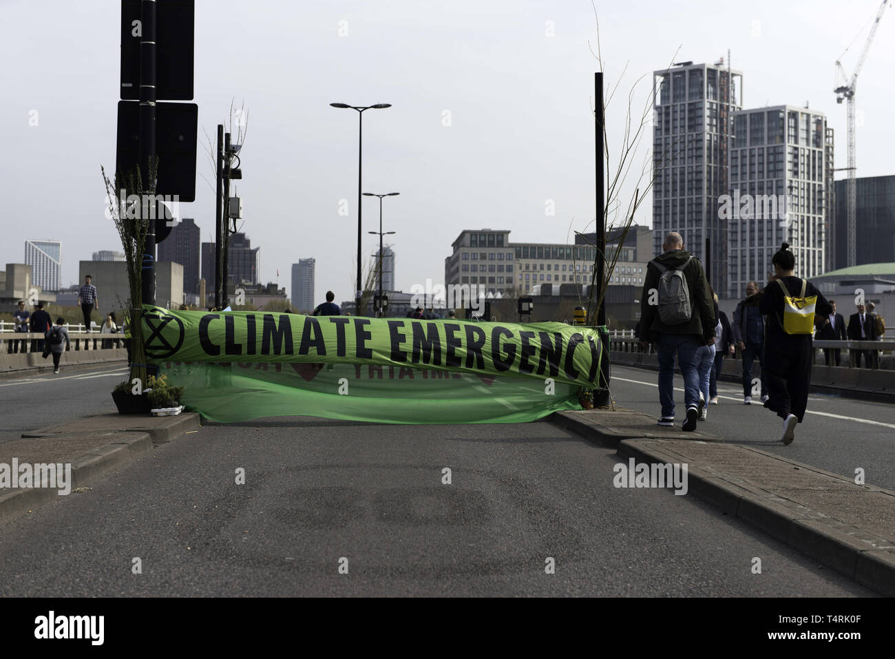 London, Greater London, UK. 18th Apr, 2019. Large Extinction Rebellion banner that reads Climate emergency is seen at Waterloo bridge blocking the street during the Extinction Rebellion Strike in London.Environmental activists from Extinction Rebellion movement hold for fourth consecutive day Waterloo Bridge in London. Activists has been parked a lorry on the bridge blocking the street causing disruptions. Police have been arresting protesters that refuse to head to Marble Arch. Extinction Rebellion demands from the government direct actions on the climate, reduce carbon emissi Stock Photo
