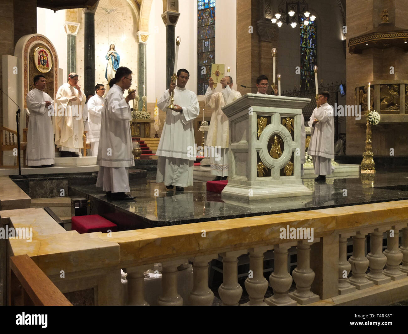 Manila Cathedral's Knights of the Altar seen preparing during the procession. Washing of the feet is a religious right observed by the Catholics, It is a form of Commandment of Jesus Christ that we should imitate his loving humility while the Manila Archbishop Luis Antonio Cardinal Tagle washes the feet of the twelve young people during the Maundy Thursday religious service at the Manila Cathedral in Manila. - Stock Image
