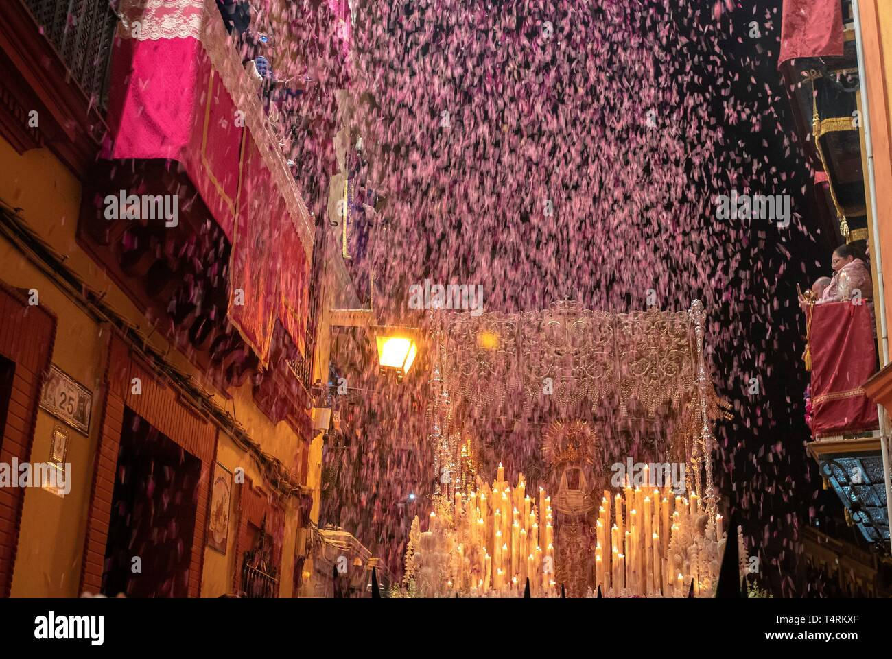 ***MANDATORY KILL*** PLEASE REMOVE THIS PICTURE FOM YOUR SERVICE AND ARCHIVES*** Petals are thrown from the balconies as the Virgin of Esperanza de Triana leaves its temple at the neighborhood of Triana during the 'Madruga' (lit: Small Hours) processions in Seville, Spain, 19 April 2019. EFE/ Julio Munoz - Stock Image