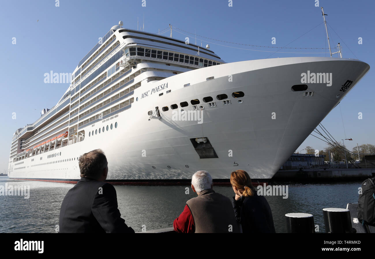 """19 April 2019, Mecklenburg-Western Pomerania, Warnemünde: The """"MSC Poesia"""", the first cruise ship of the new season, has moored at the passenger quay. The 293 metre long ship can accommodate up to 4000 passengers and crew members. This year, 41 ships are expected to dock here almost 200 times. Photo: Bernd Wüstneck/dpa Stock Photo"""