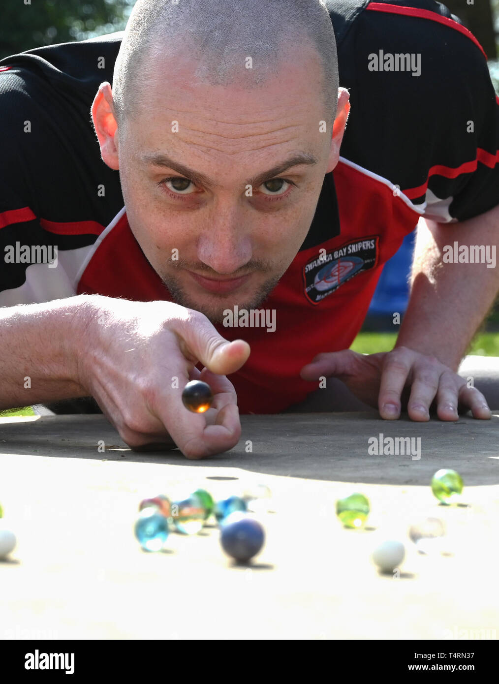 Crawley Sussex, UK. 19th Apr, 2019. Lloyd Evans from the Swansea Bay Packers competing in the World Marbles Championship held at The Greyhound pub at Tinsley Green near Crawley in Sussex . The annual event has been held on Good Friday every year since the 1930s and is open to players from around the world Credit: Simon Dack/Alamy Live News Stock Photo
